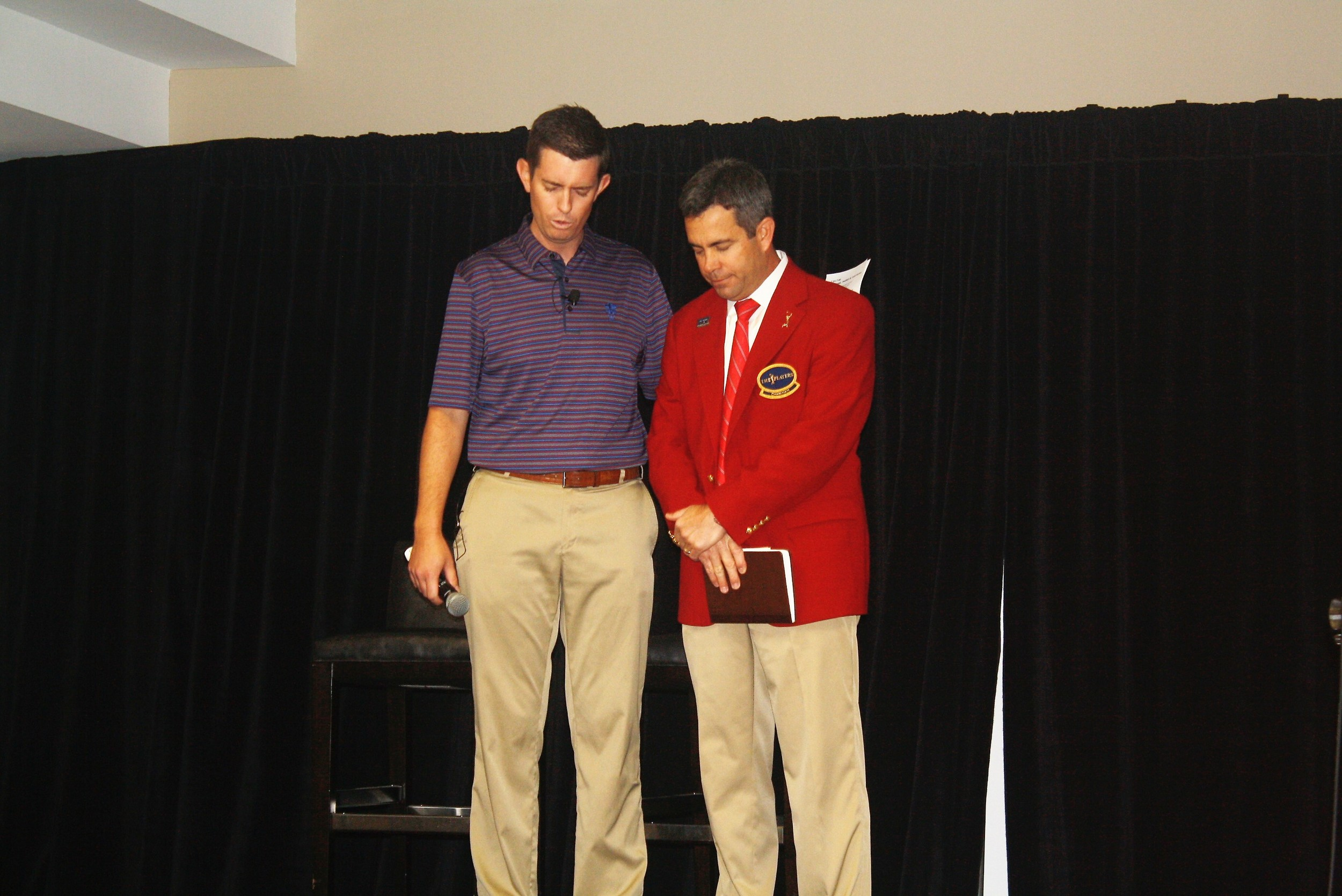 Matt Roop leads guests in prayer for Tournament Chairman Kevin English and THE PLAYERS' 2,000 volunteers.