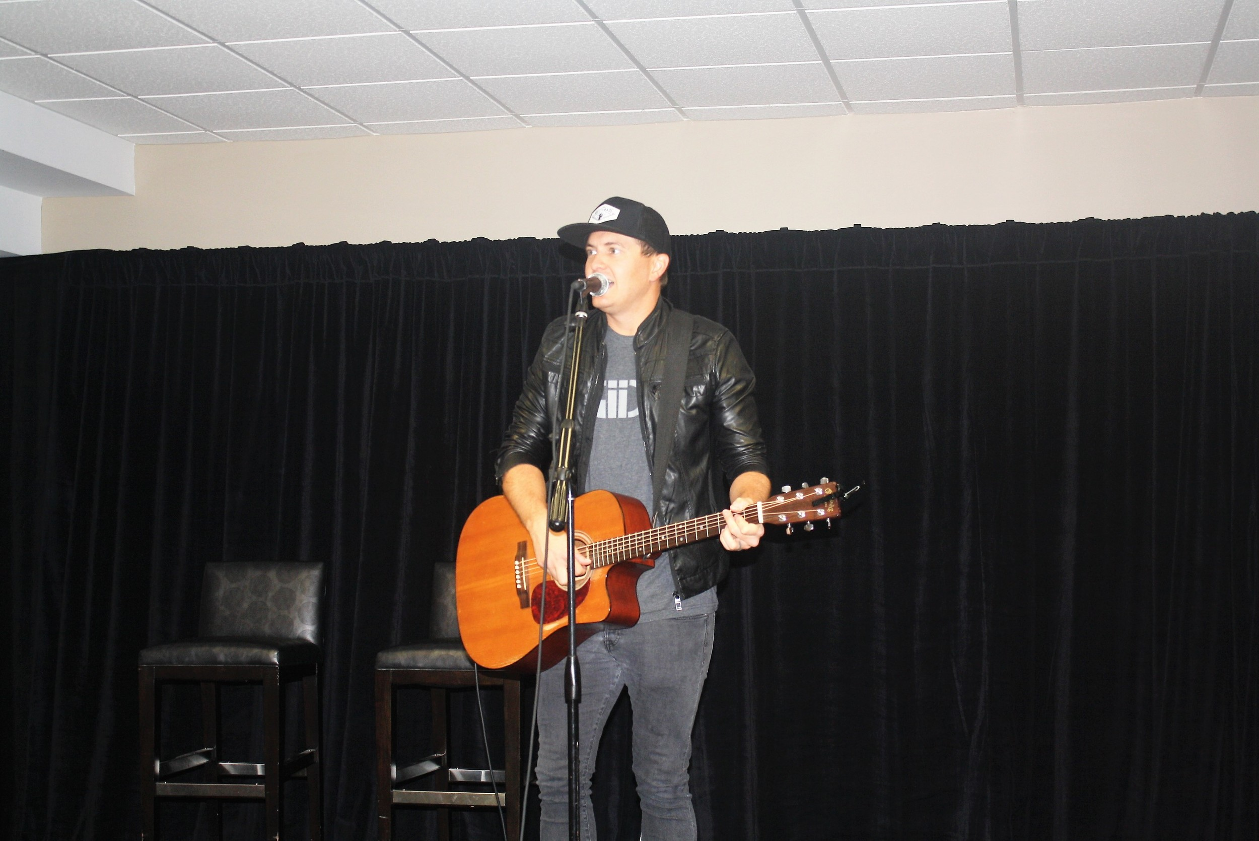 Audio Adrenaline's Adam Agee entertains youth golfers at the Breakfast with the Pros.