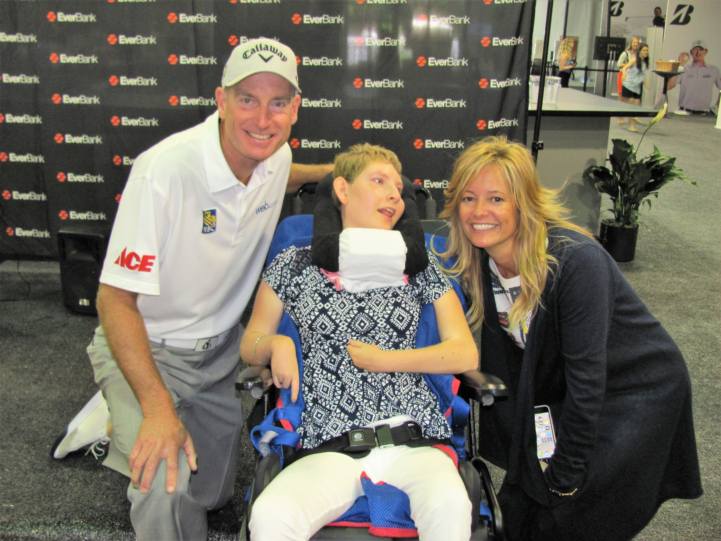 Jim and Tabitha Furyk greet one of the children from Community PedsCare.