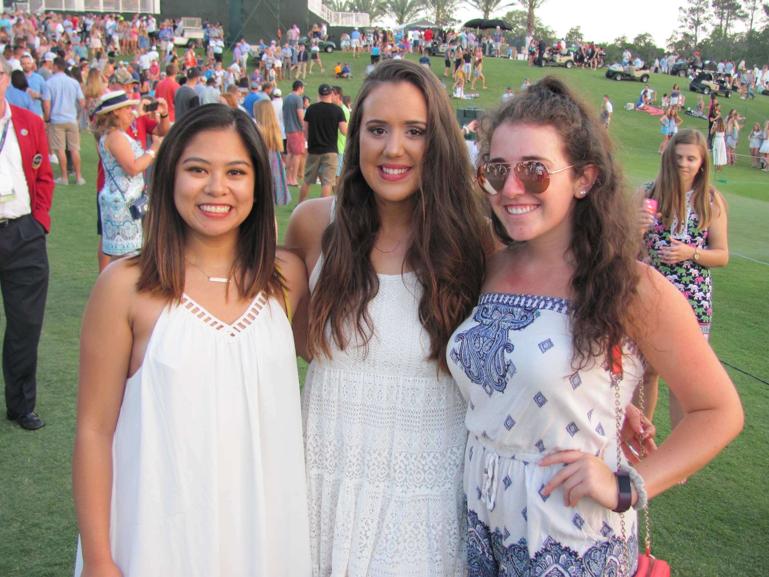 Ayeesha Deleon, Kayla Shirk and Cathryn O'Brien gather after the military appreciation ceremony and Sam Hunt concert