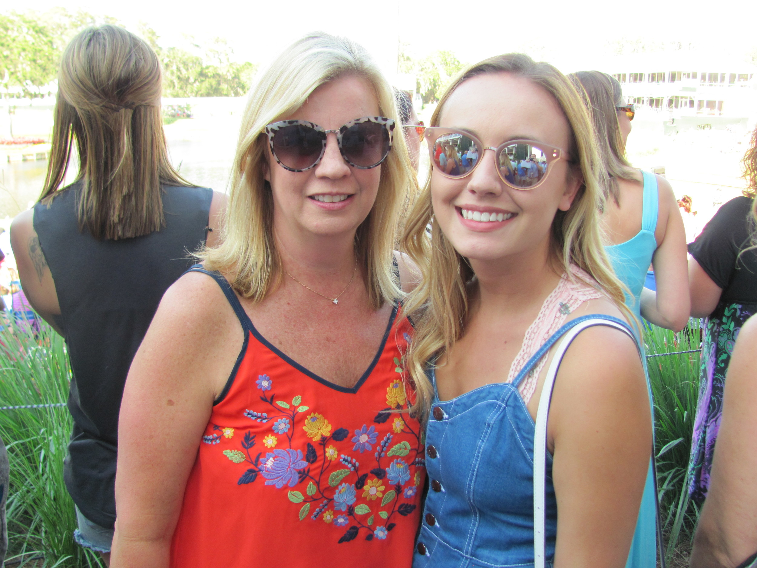 Lisa and Lindsay Hugo join the packed crowd at the 17th hole for the military appreciation ceremony and Sam Hunt concert.
