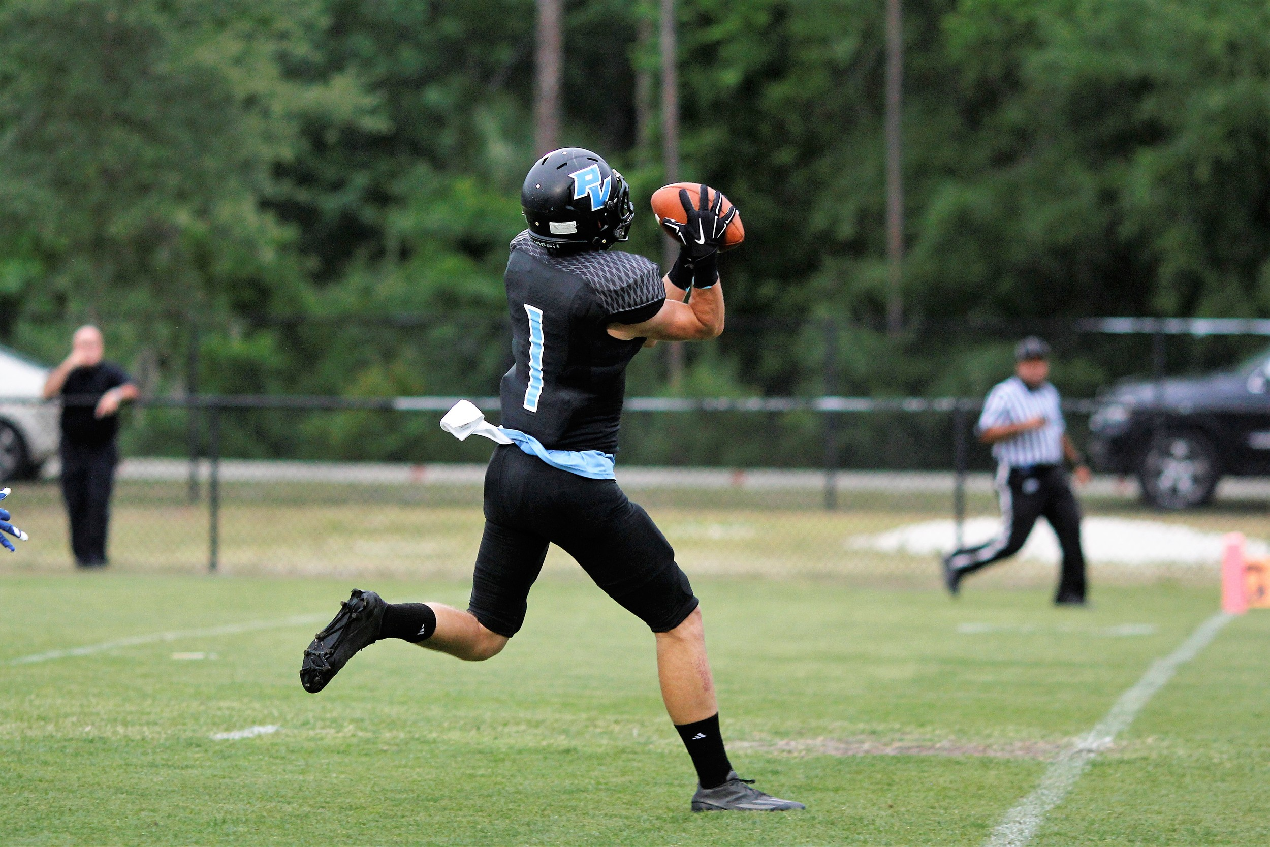 Senior Jarrett Stepp (#1) hauls in the over the shoulder touchdown pass for the first Shark score.