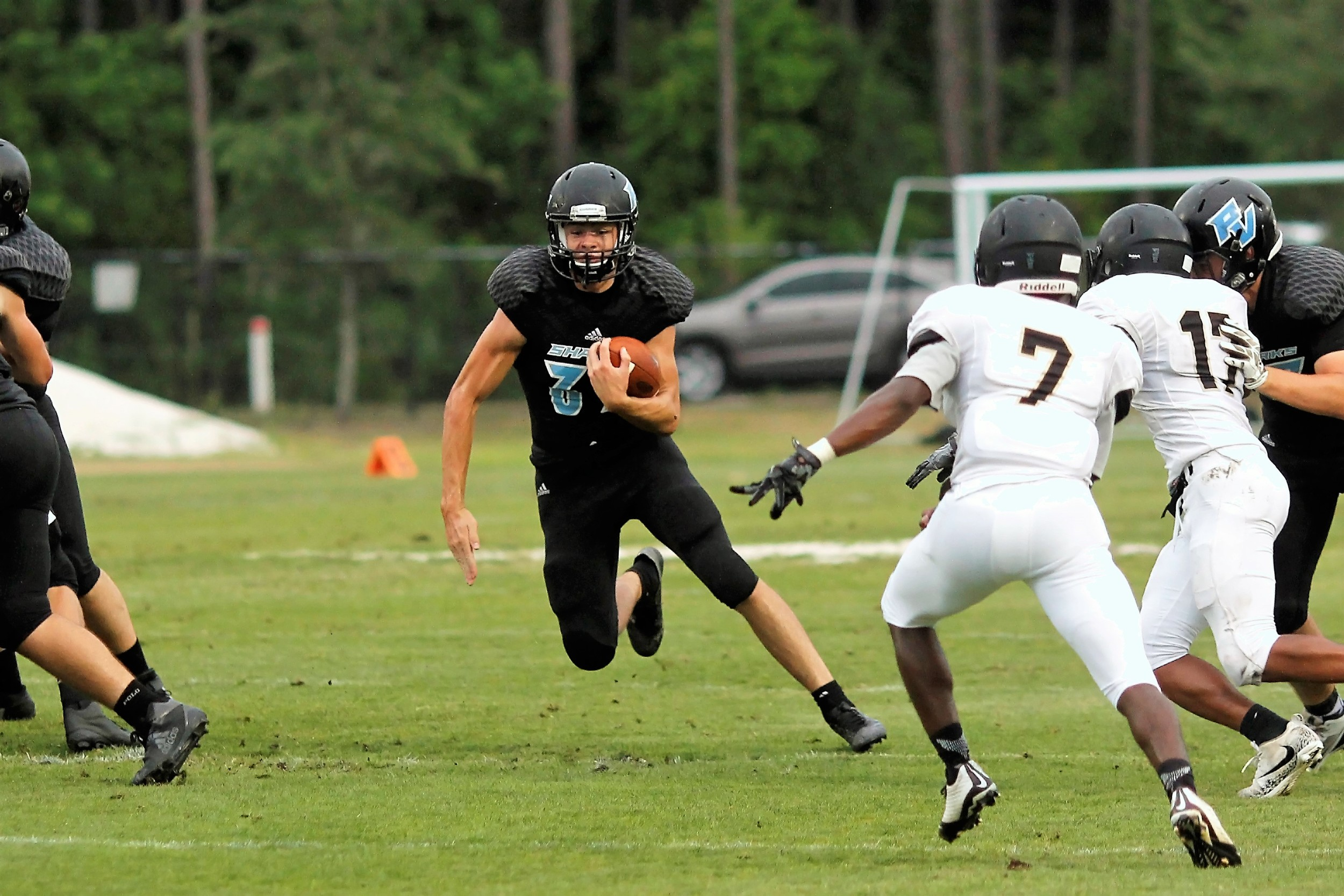 Running back Zach King carries the ball through a big hole.