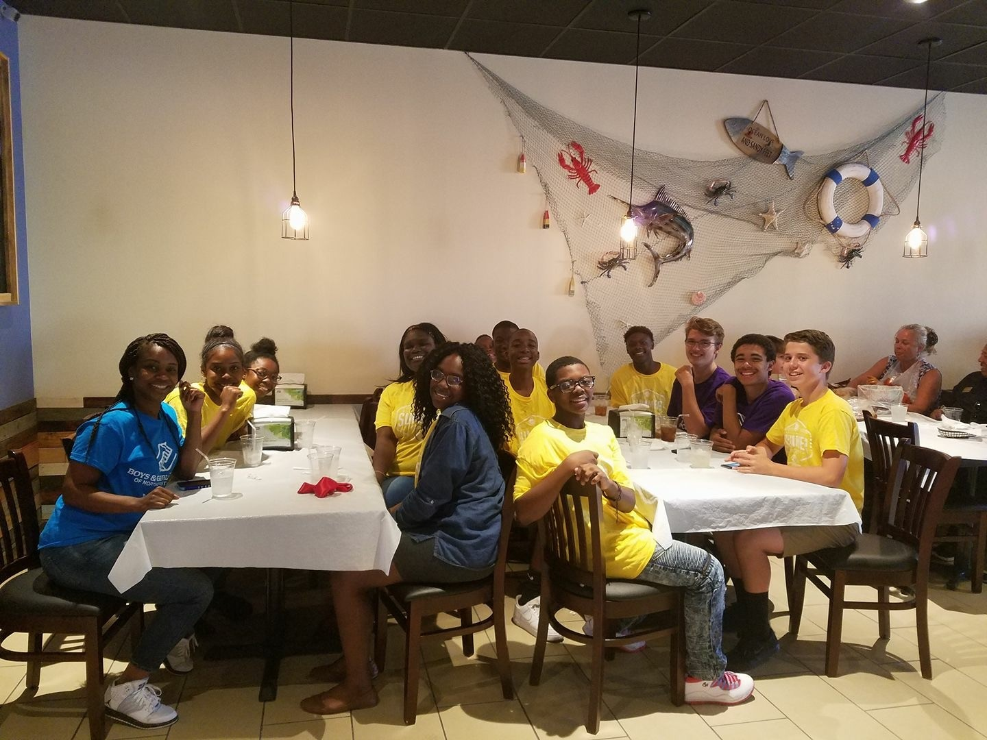 Beaches Boys & Girls Club members enjoy a free dinner at Spicy & Juicy Crawfish.