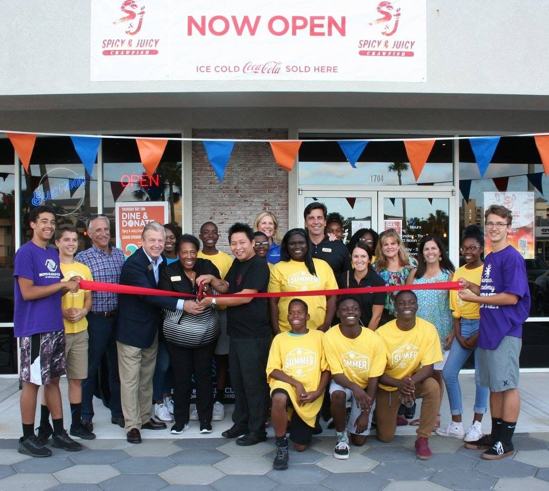 Beaches Boys & Girls Club board members, staff and club members celebrate the opening of Spicy & Juicy Crawfish with restaurant owner Benny Chen.