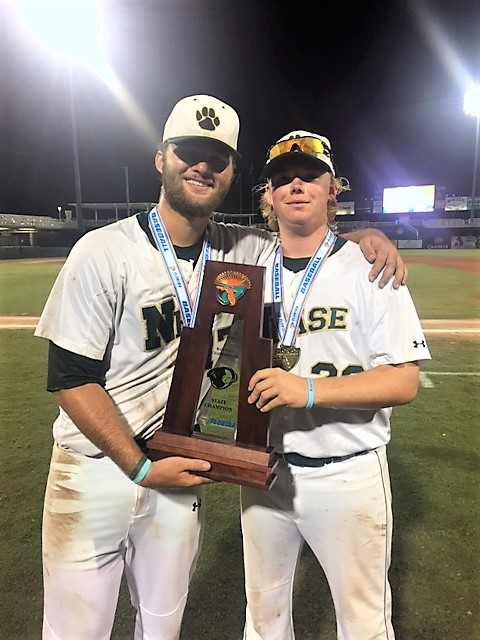 Nease pitchers Leighton Alley and Eric Linder display the state championship trophy. The Nease baseball team captured its first state title last week, defeating King High School 11-0 in the Class 7A title game.