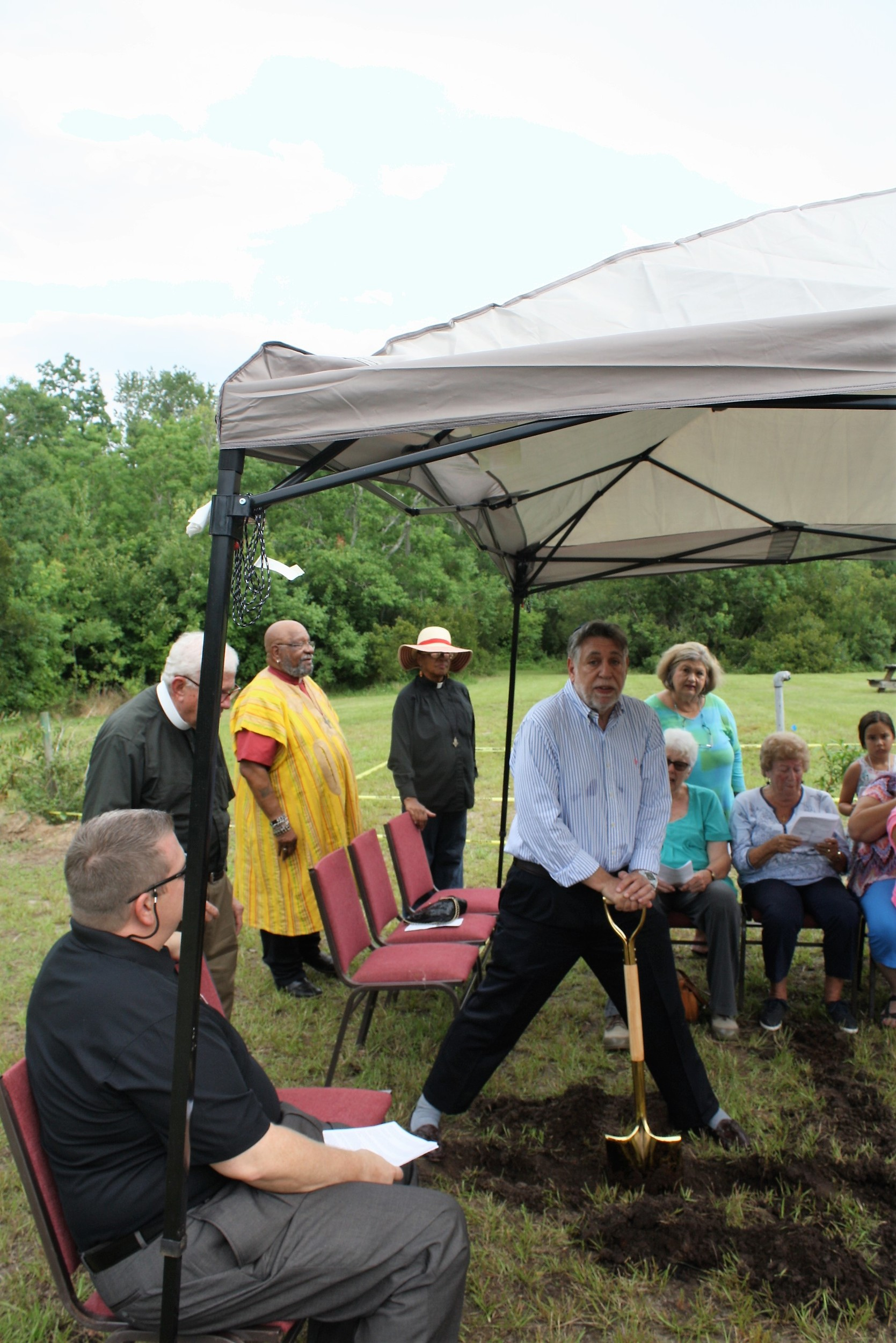 Rabbi Michael Matuson of Beth El at the Beaches offers a Hebrew blessing at the ground breaking ceremony.