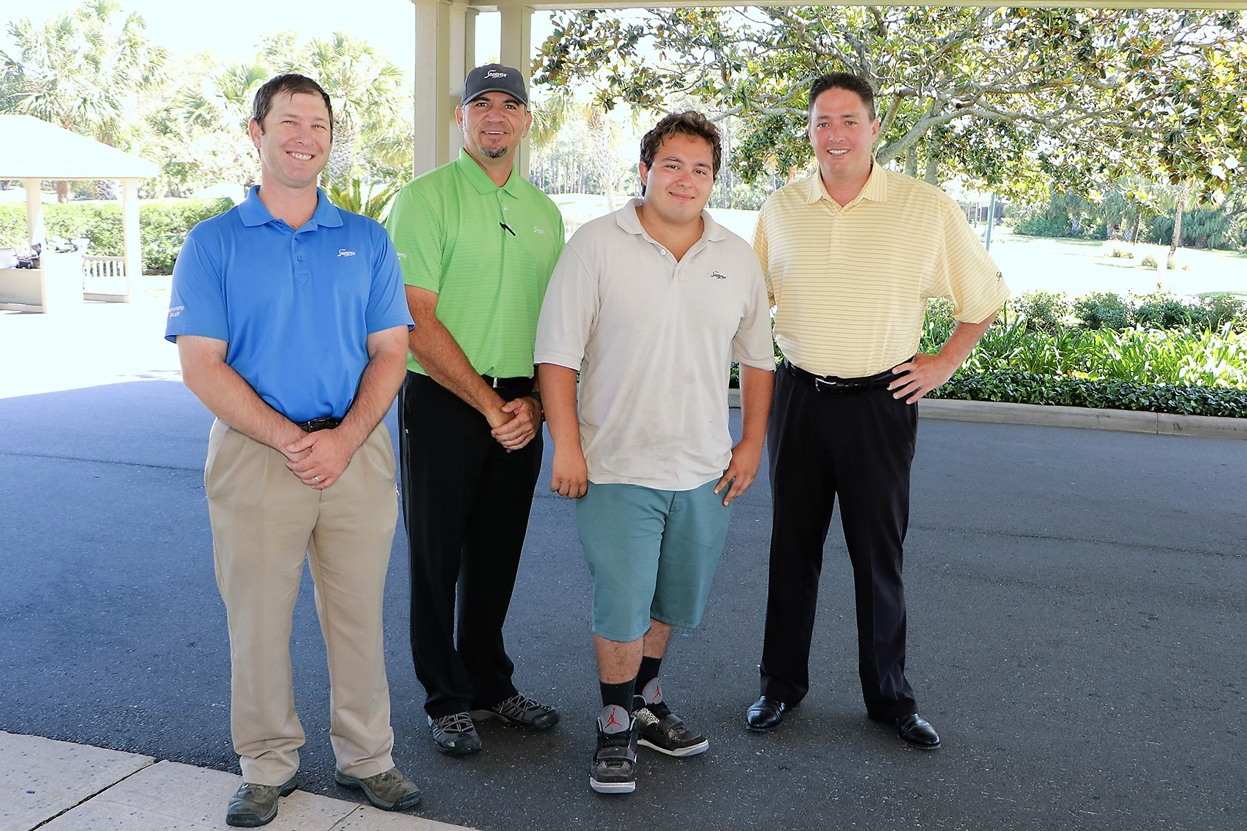 Sawgrass Country Club Golf Course Superintendent Bill Schmidt, Director of Agronomy Matt Durkee, scholarship recipient Emilio Mirabilio and General Manager Barry McDonald