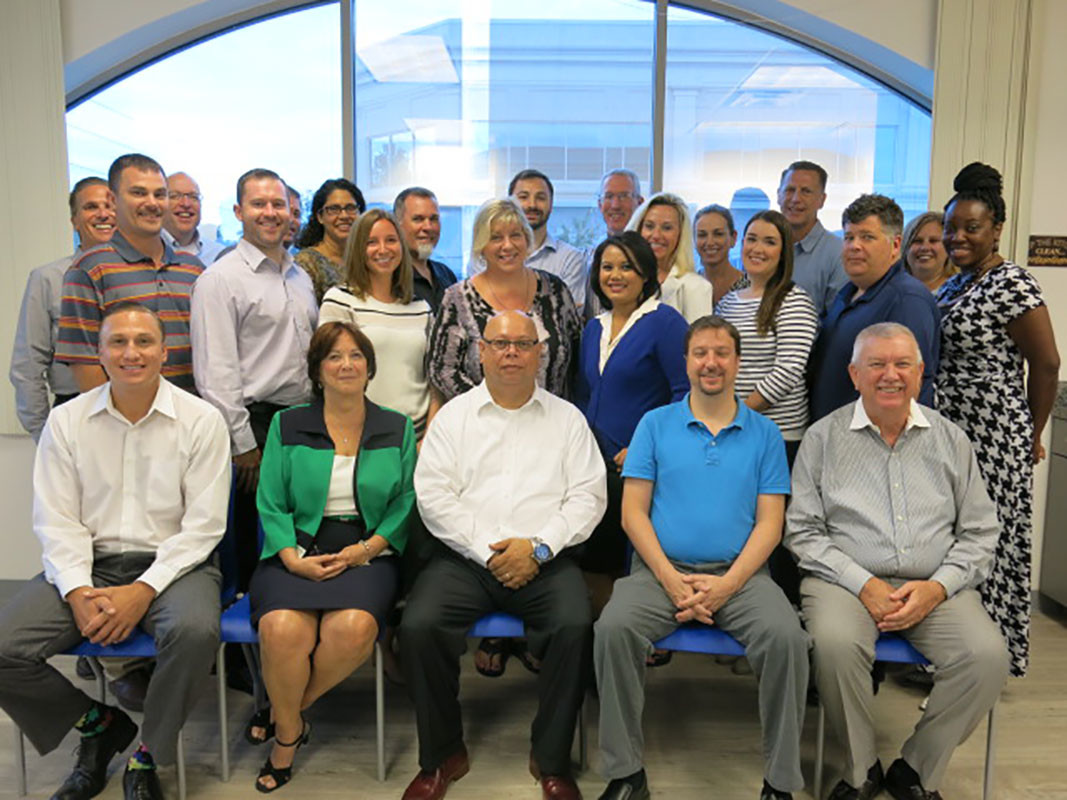 Navitas Credit Corp. employees gather for a team photo at the company's Ponte Vedra Beach headquarters.