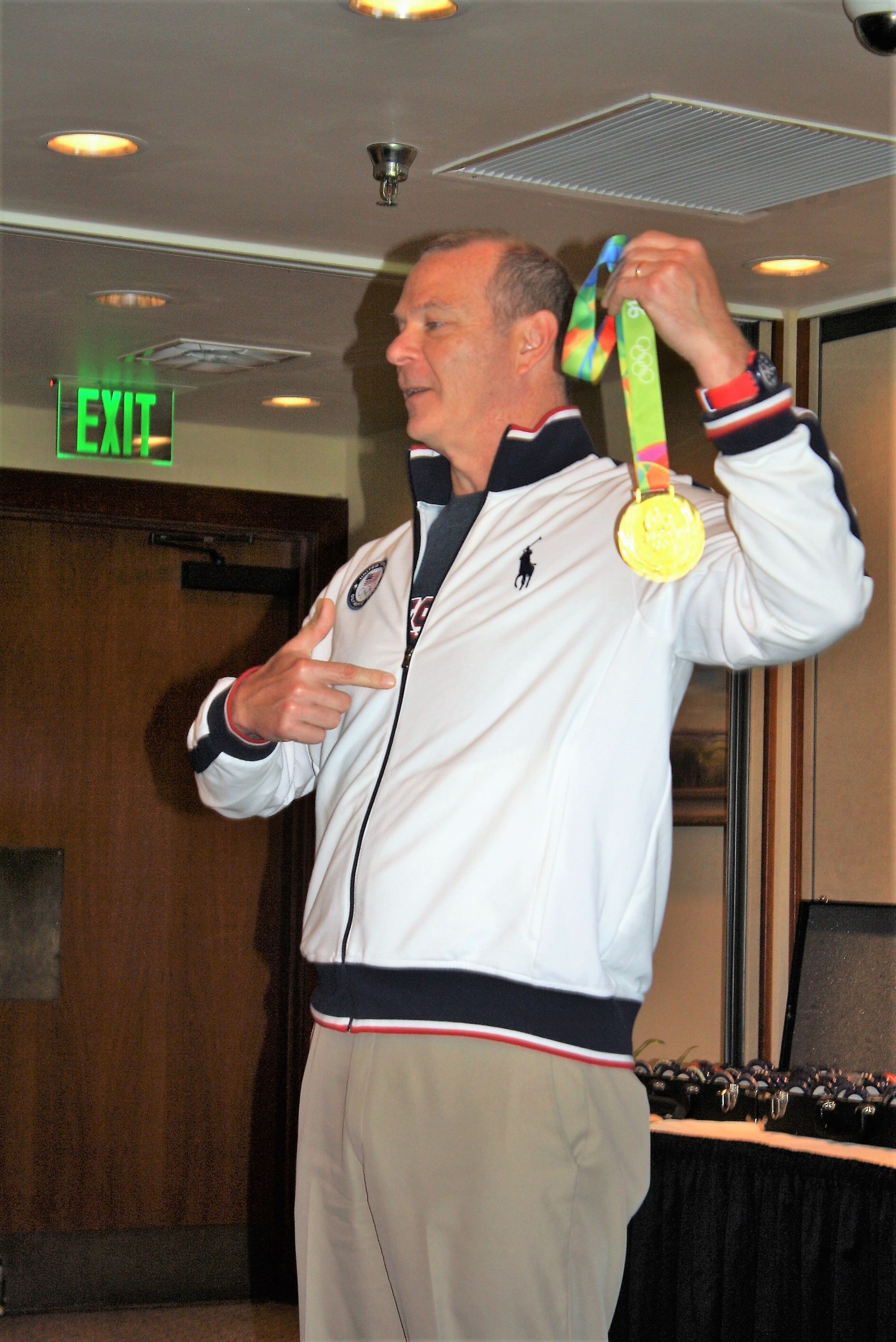 Patrick Murphy displays one of the three gold medals his son won at the 2016 Summer Olympics in Rio.
