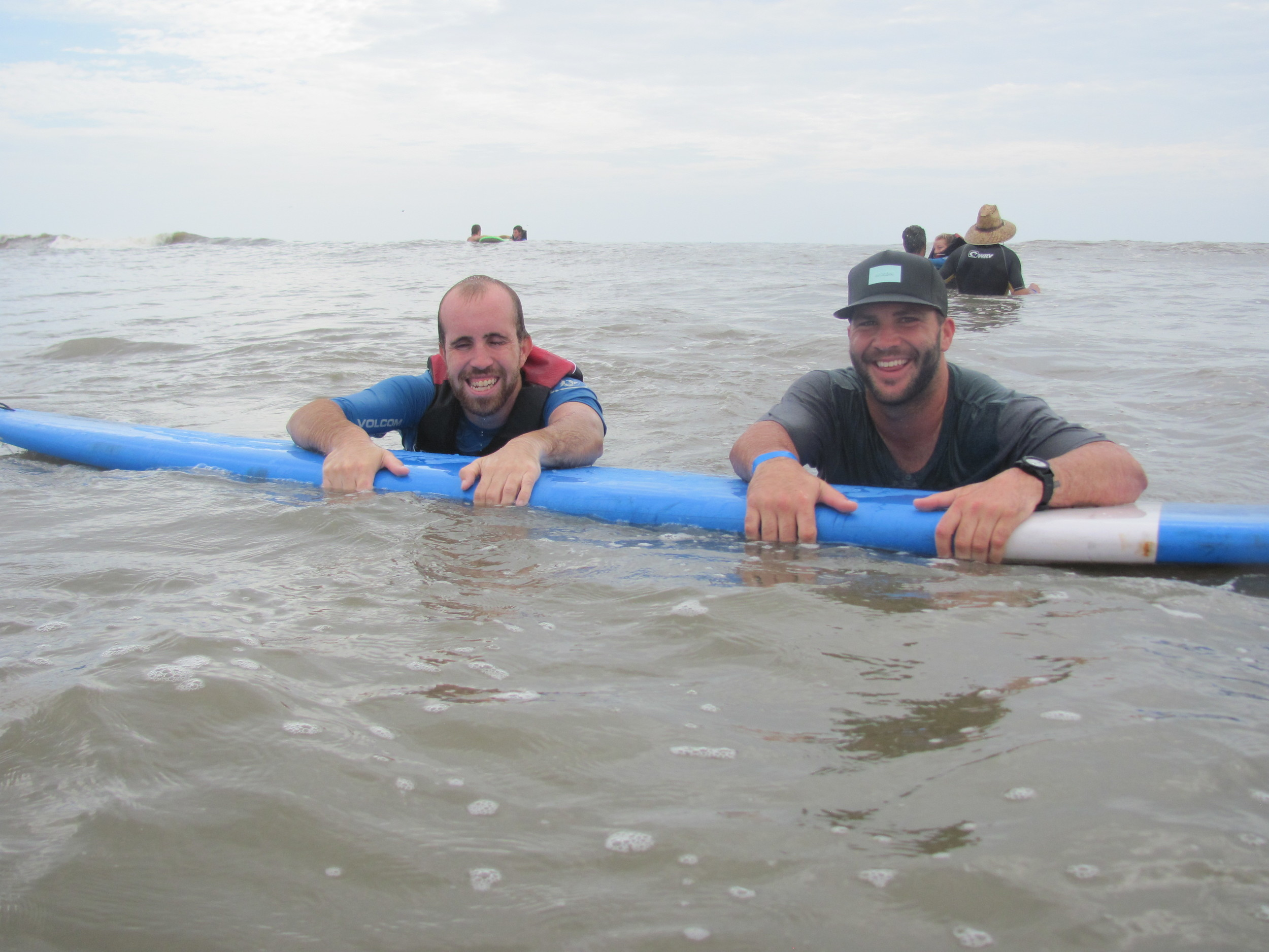 Jacksonville Jaguars quarterback Blake Bortles (right) helps a camper in the water.