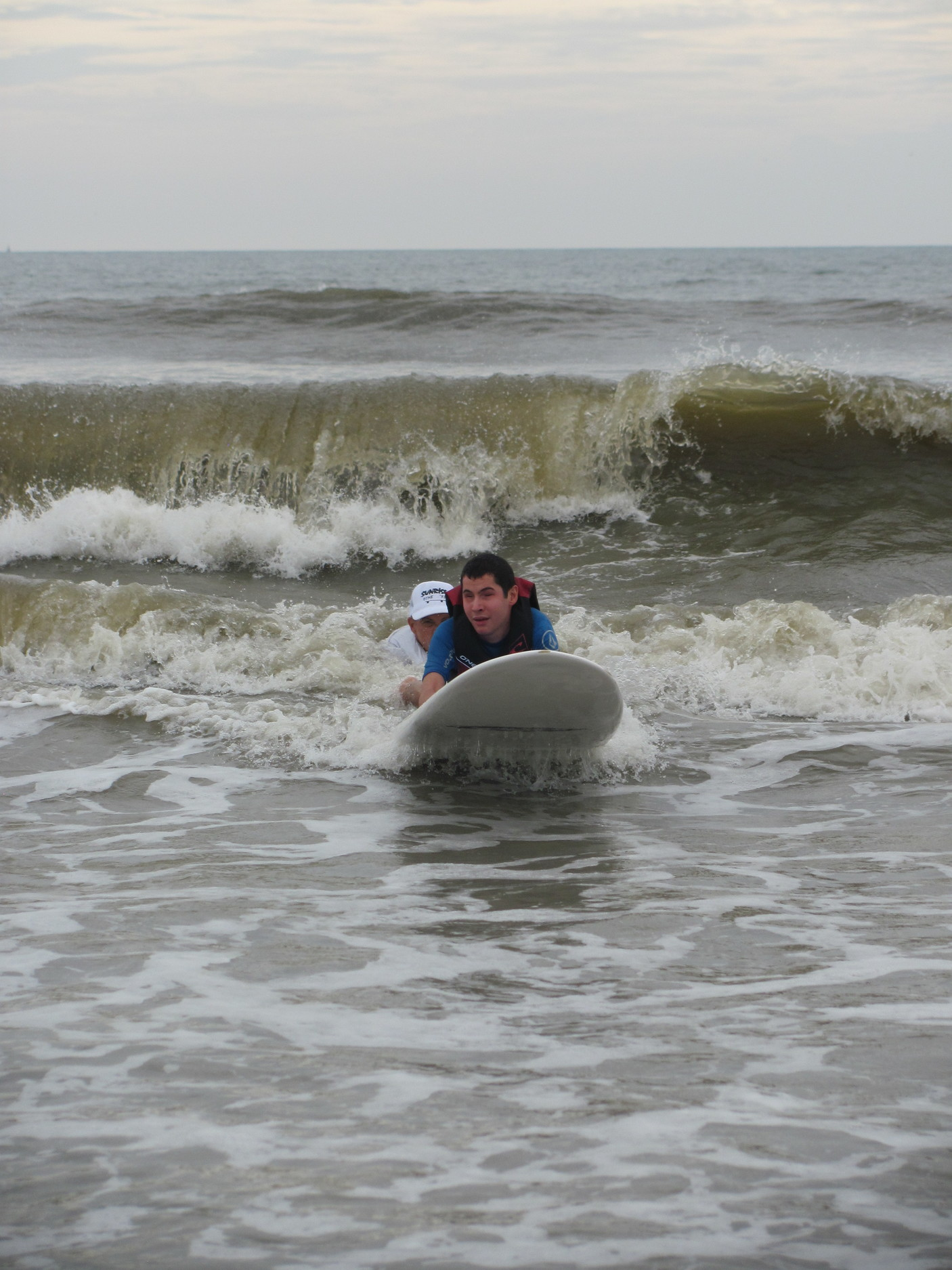 Max, a camp participant for the past 10 years, jets towards the shore after catching a long wave.