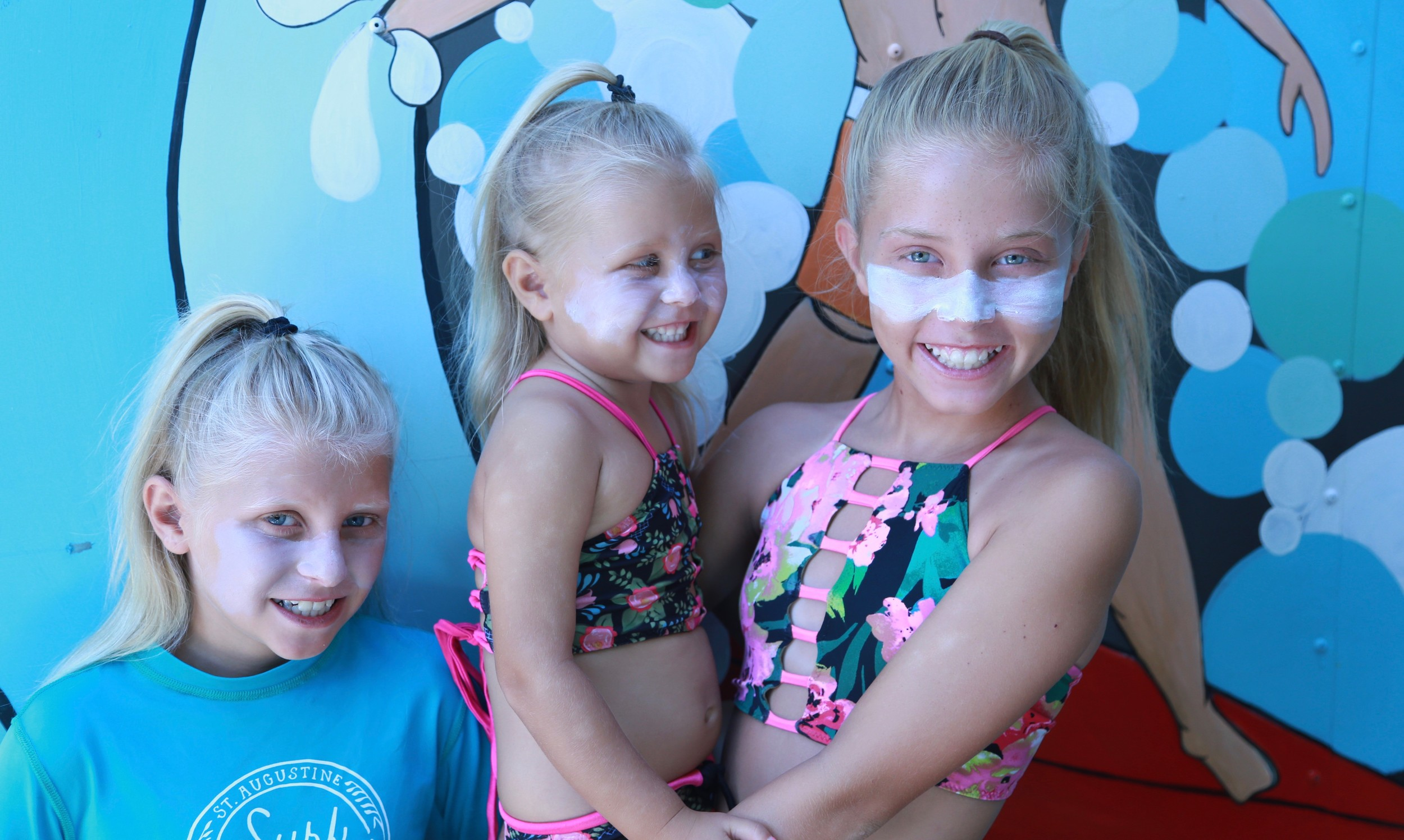 Lauren and Dustin Estes' daughters Sunny, Sage and Shaylee wear Tribe Apothecary's zinc-based sun block.