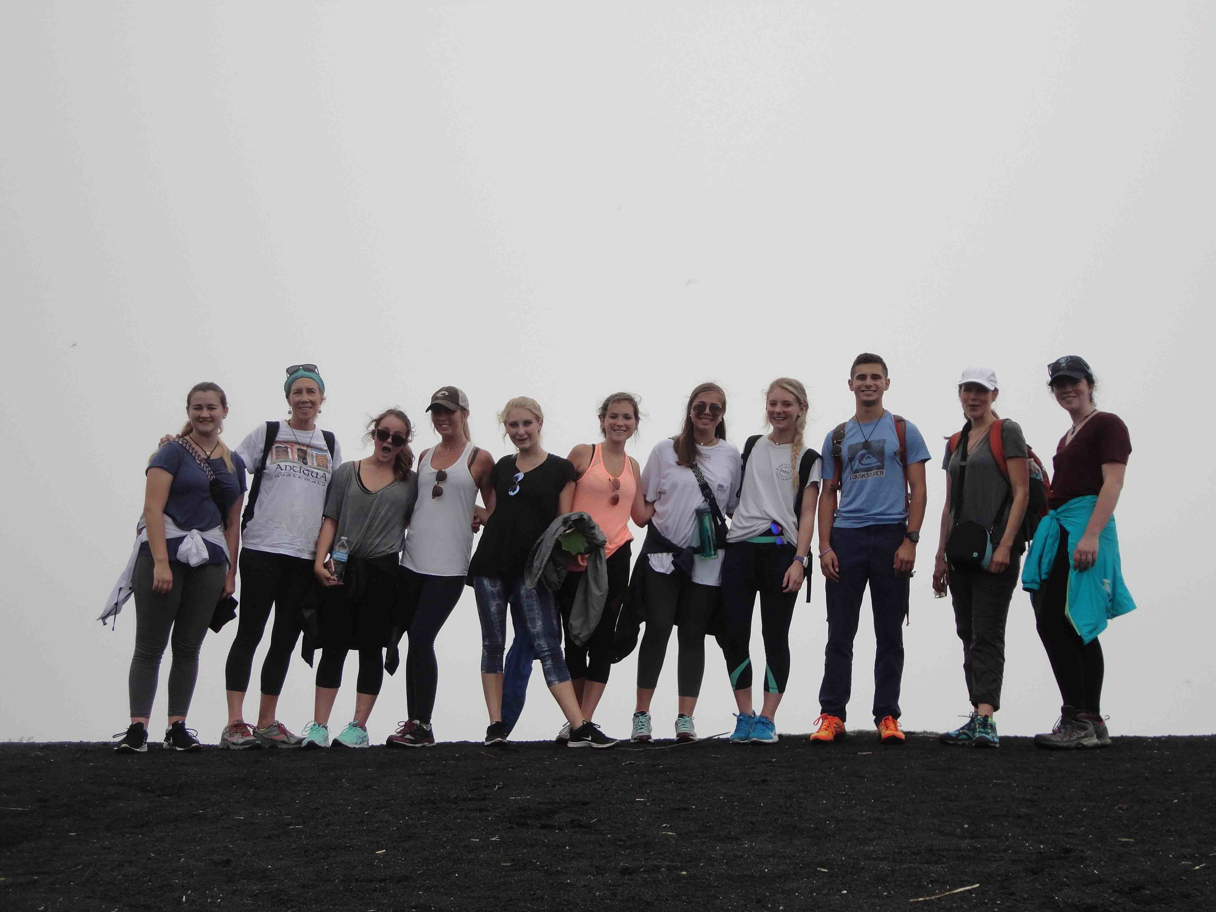 The group reaches the summit of the Pacaya Volcano, outside of Antigua.