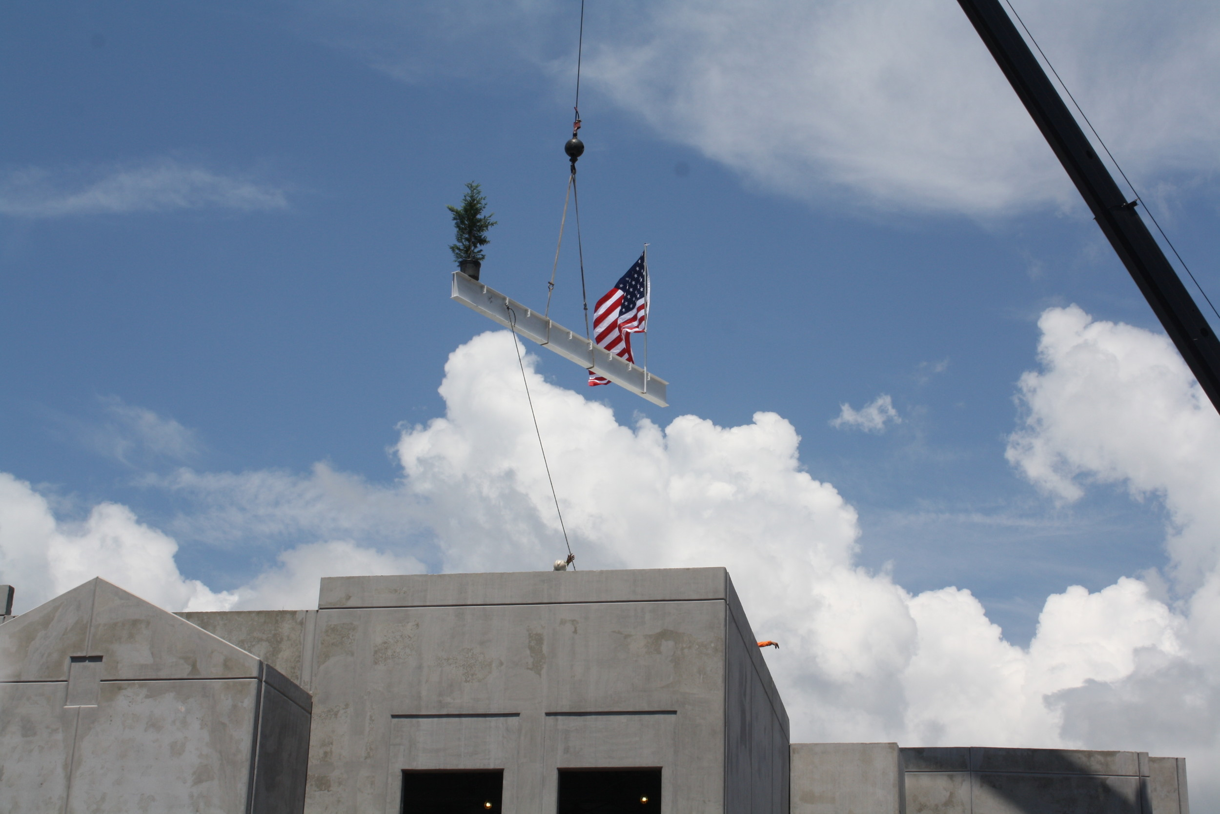 "A crane lifts the final steel beam atop the new K-8 school in Nocatee at a ""topping out"" ceremony held last week."