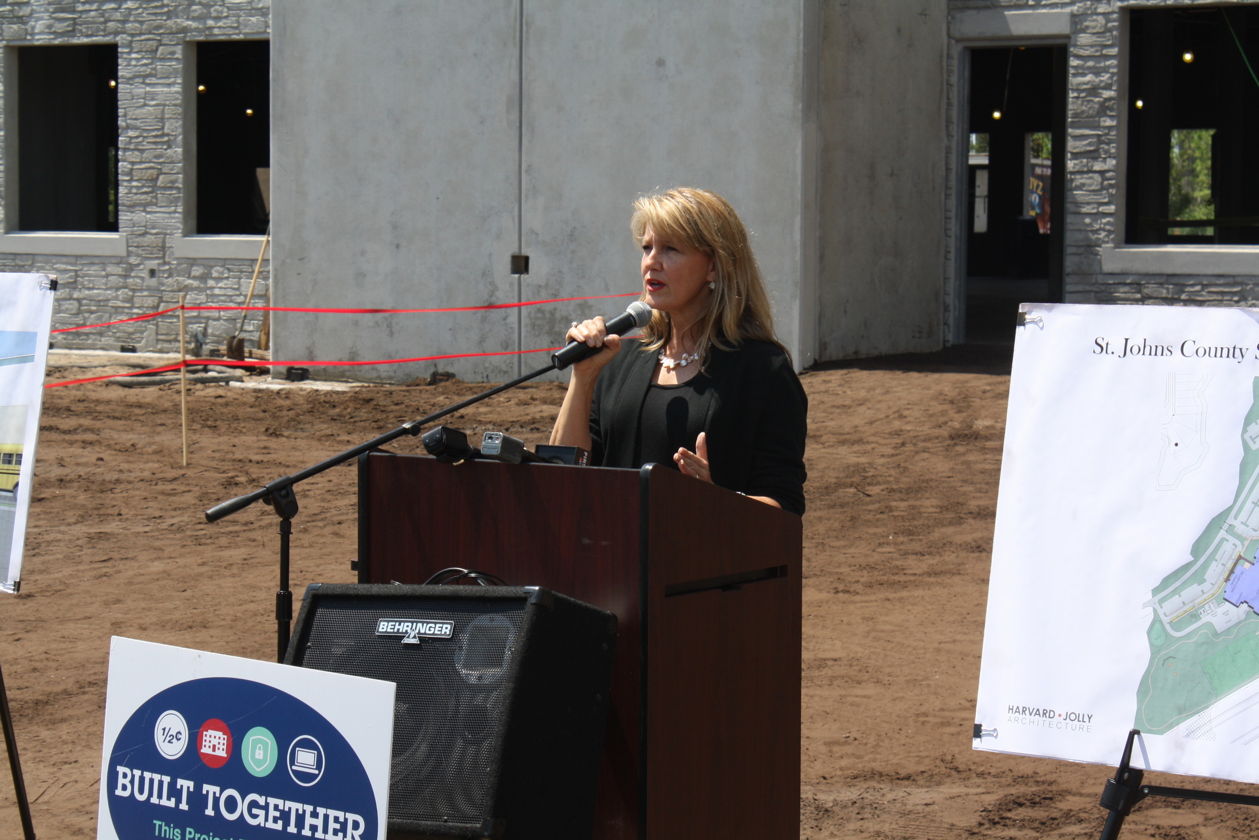 "SJCSD District 4 School Board Member Kelly Barrera addresses attendees of the school's ""topping out"" ceremony."