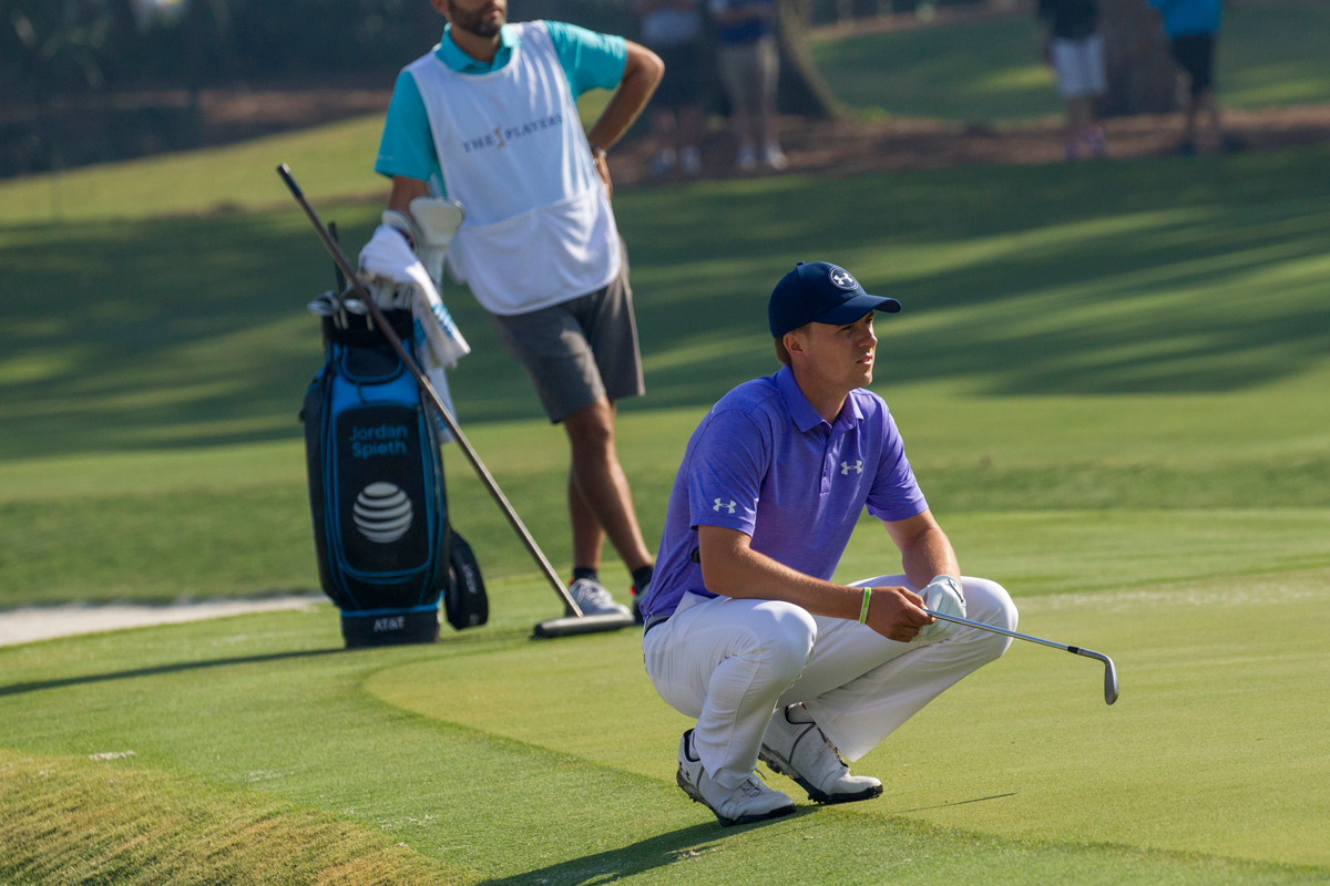 Jordan Spieth assesses his next stroke at THE PLAYERS in May.
