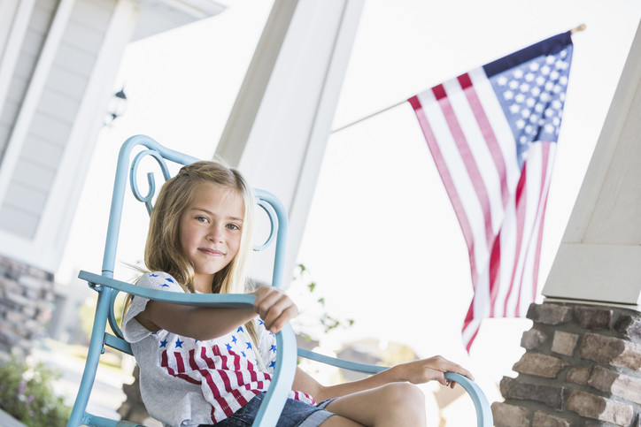 The homes in the new neighborhoods will harken back to old-town America, featuring white picket fences, big front porches and the American flag.