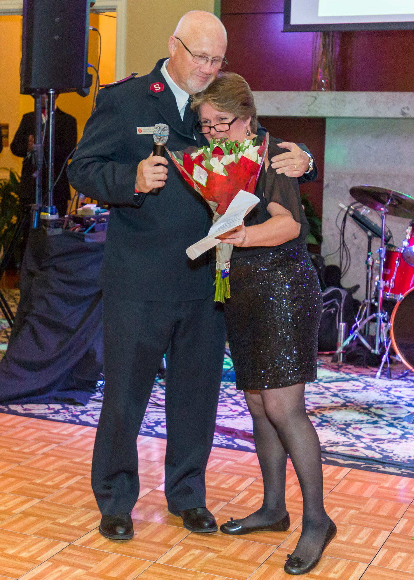 Major Rob Vincent congratulates former shelter resident Wendy Shaw at the 2016 Red Shield Ball on her success since graduating from the program.