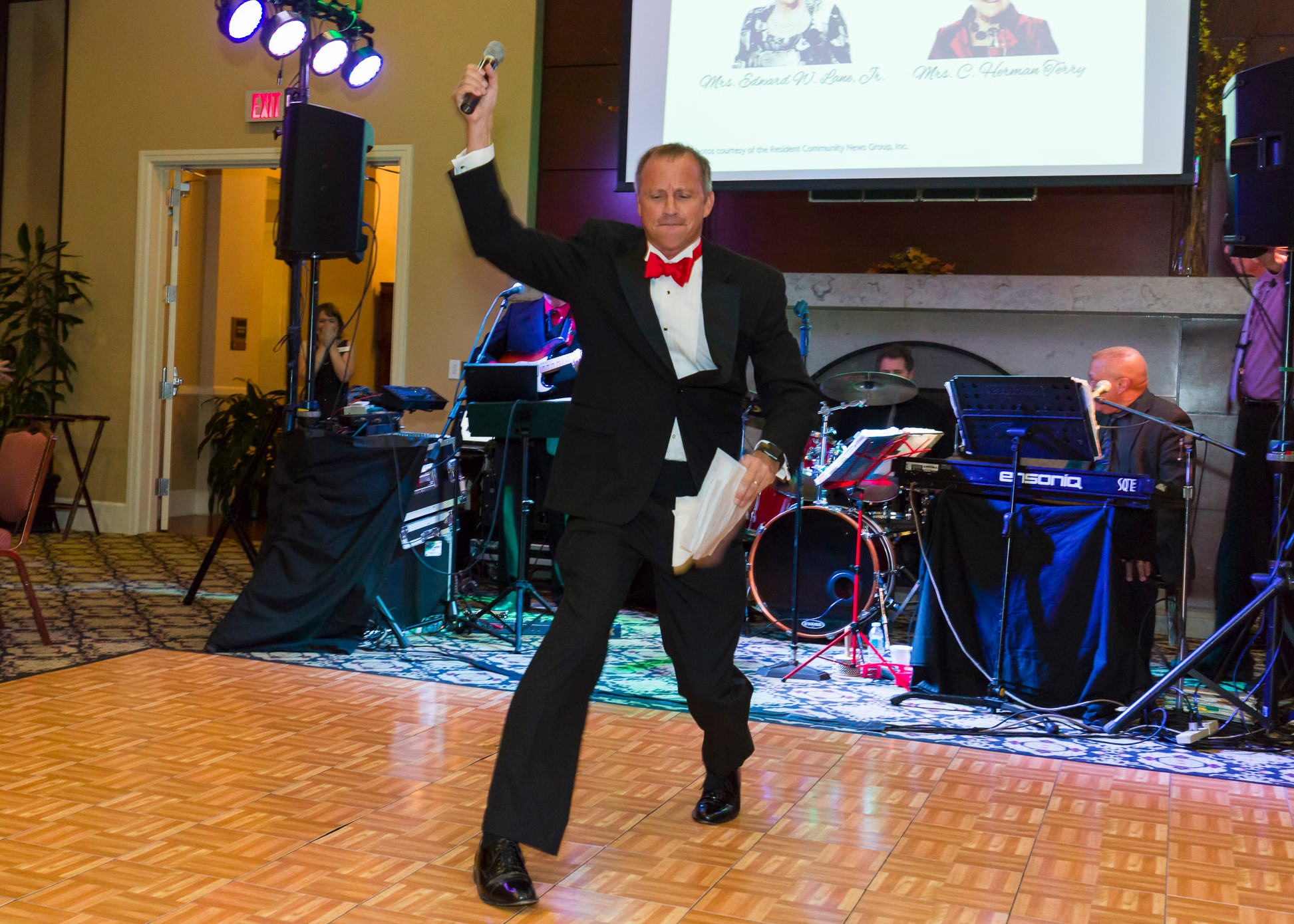 "2016 Red Shield Ball Emcee and Salvation Army former Board Chair Mike Buresh throws the mic after announcing the results of the 2016 ""Fund-A-Need."""