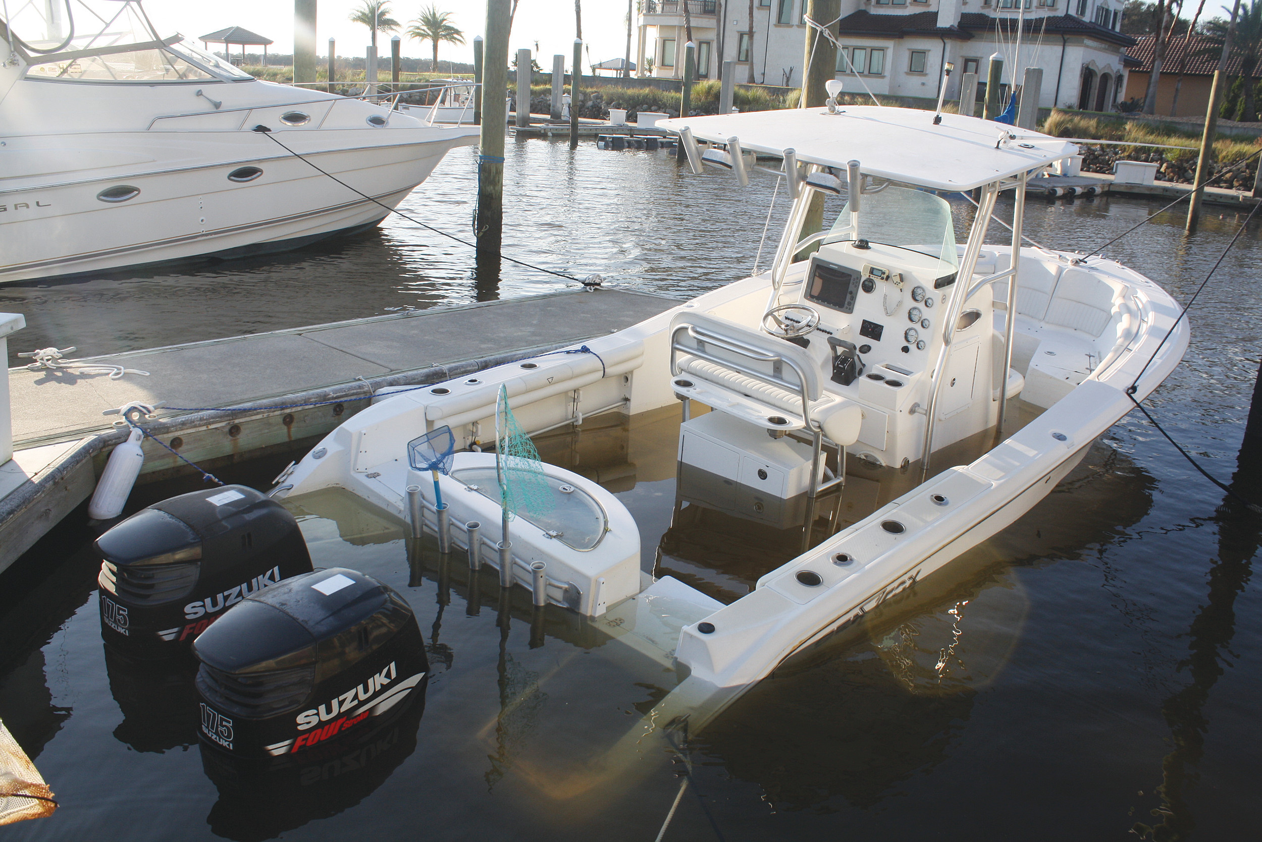 A boat docked in the Vilano Beach area struggles to stay afloat after taking on water from Hurricane Irma.