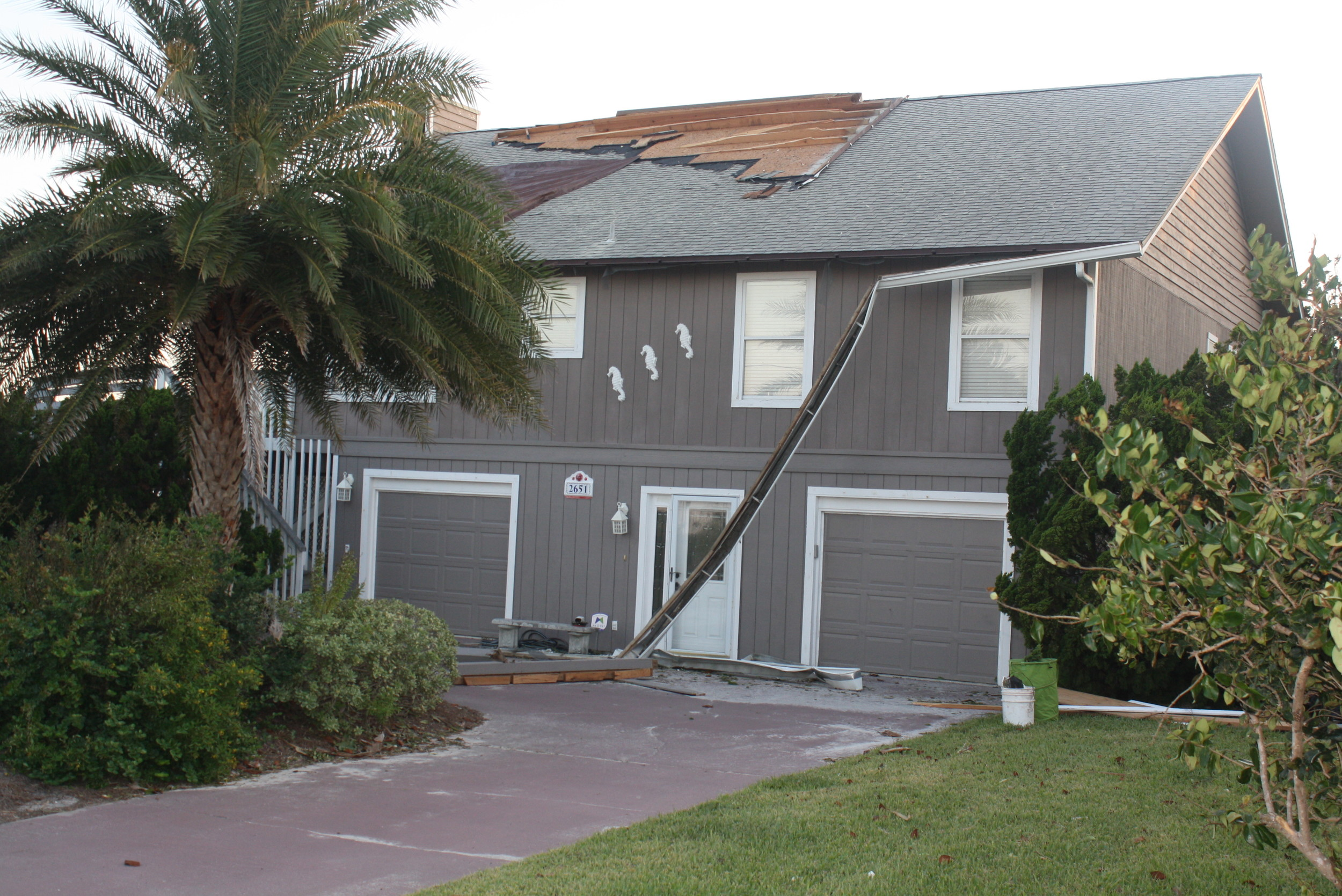 A house in the Porpoise Point neighborhood of Vilano Beach is left without parts of its roof after Hurricane Irma.
