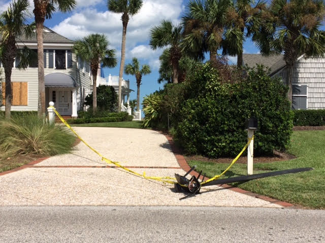 A Ponte Vedra Boulevard home loses a lamp post due to the storm.