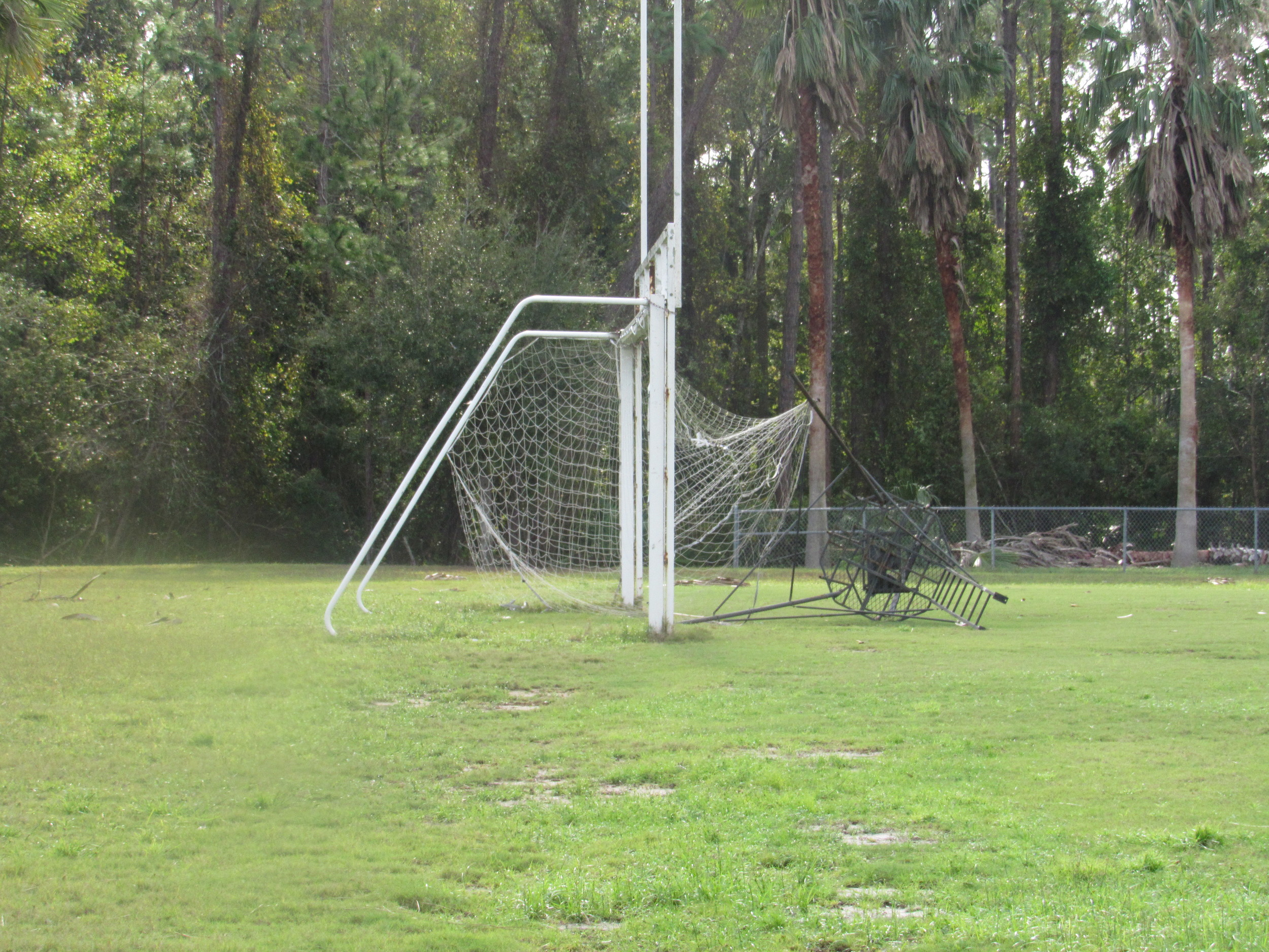 A soccer net at Ponte Vedra High School is damaged by debris.