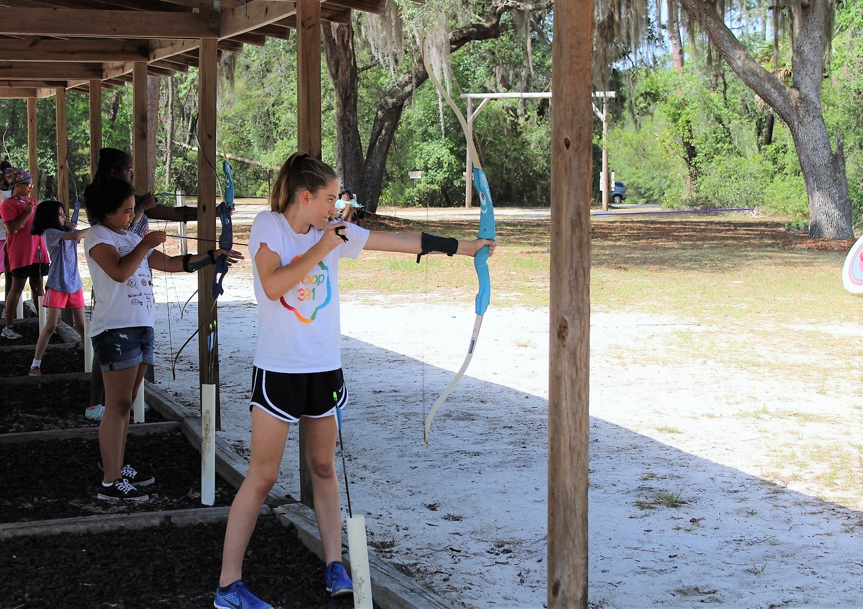 Girl Scouts fine-tune their archery skills.