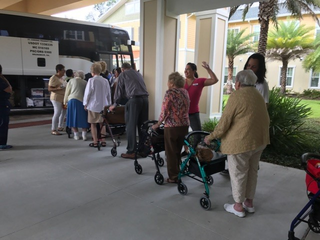 Residents of The Palms at Ponte Vedra board a bus to evacuate to the Crowne Plaza hotel near the Jacksonville International Airport.