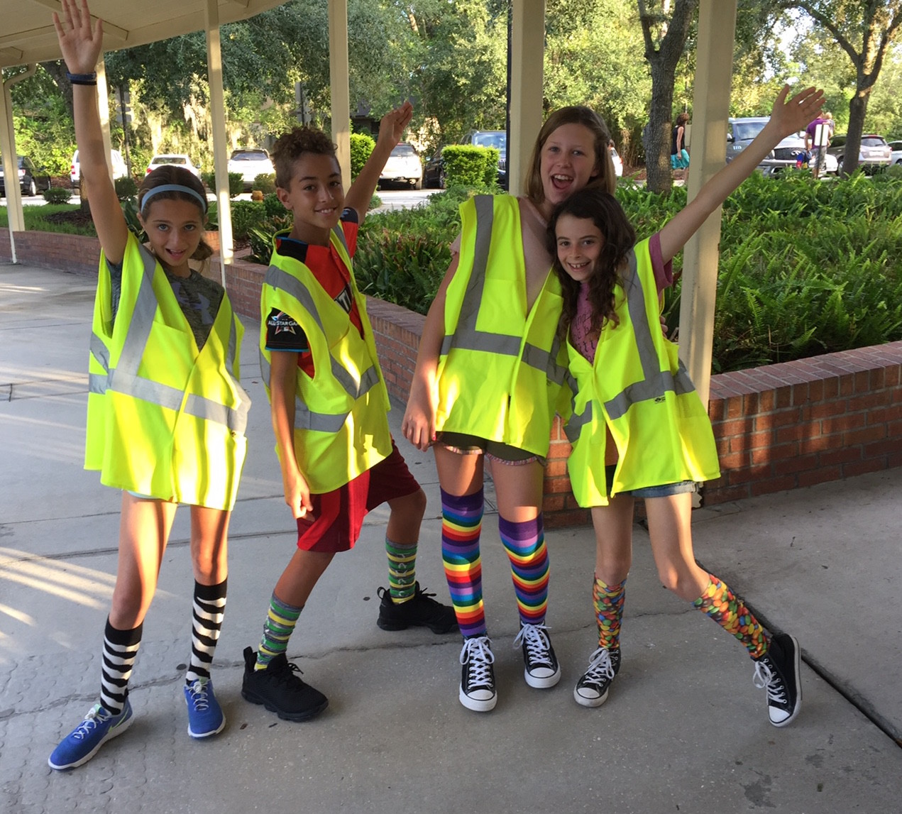 "Jacksonville Country Day School (JCDS) students, including Ponte Vedra Beach residents Ellie Goodfriend (far left) and Izzy Davis (far right), ""break"" the school's dress code Sept. 1 to raise money for those impacted by Hurricane Harvey. Students were asked to donate $1 for the privilege of breaking the dress code. Overall, students raised $2,218, which will be donated to the United Way of Greater Houston."