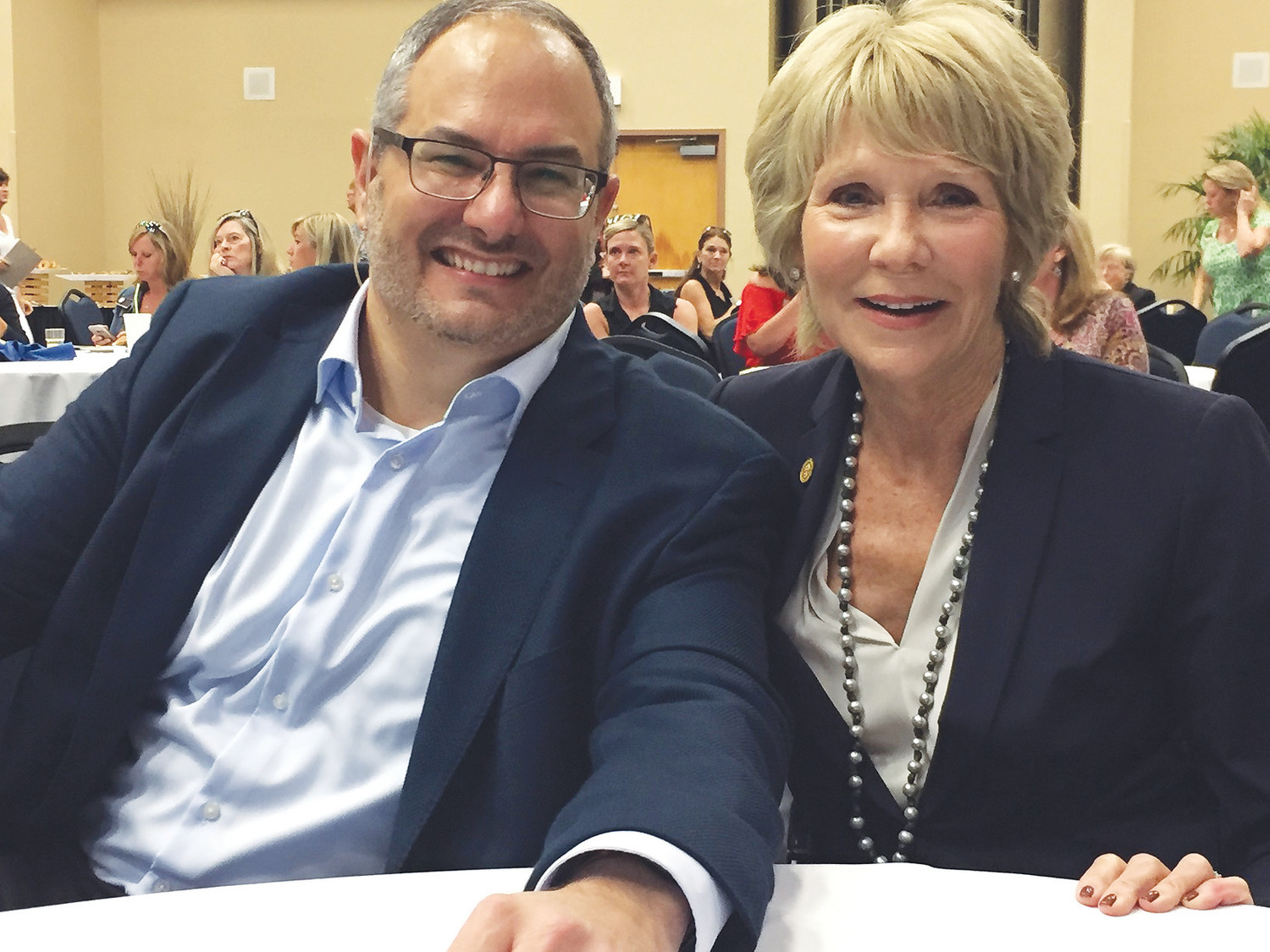 Speaker Matthew Ferrara poses with Berkshire Hathaway HomeServices Florida Network Realty Founder, President and CEO Linda Sherrer during a writing workshop hosted by the realty company.