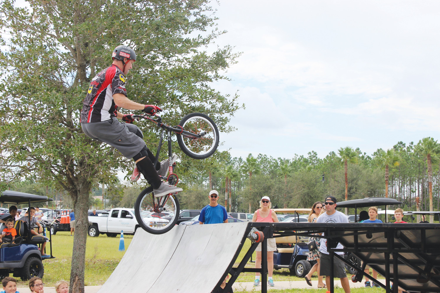 A member of Perfection on Wheel's BMX Pros Trick Team performs a half-pipe trick in front of the crowd at the Nocatee Farmers Market Sept. 16. In addition to this action-packed show, visitors at the market enjoyed checking out over 70 vendors offering items such as organic produce, herbs, spices, unique foods, crafts, jewelry and more. The next Nocatee Farmers Market is Oct. 21, inviting the community to get into the fall spirit with Nocatee's annual Fall Festival. The event takes place the third Saturday of each month on the Farmers Market Field at Nocatee Town Center.