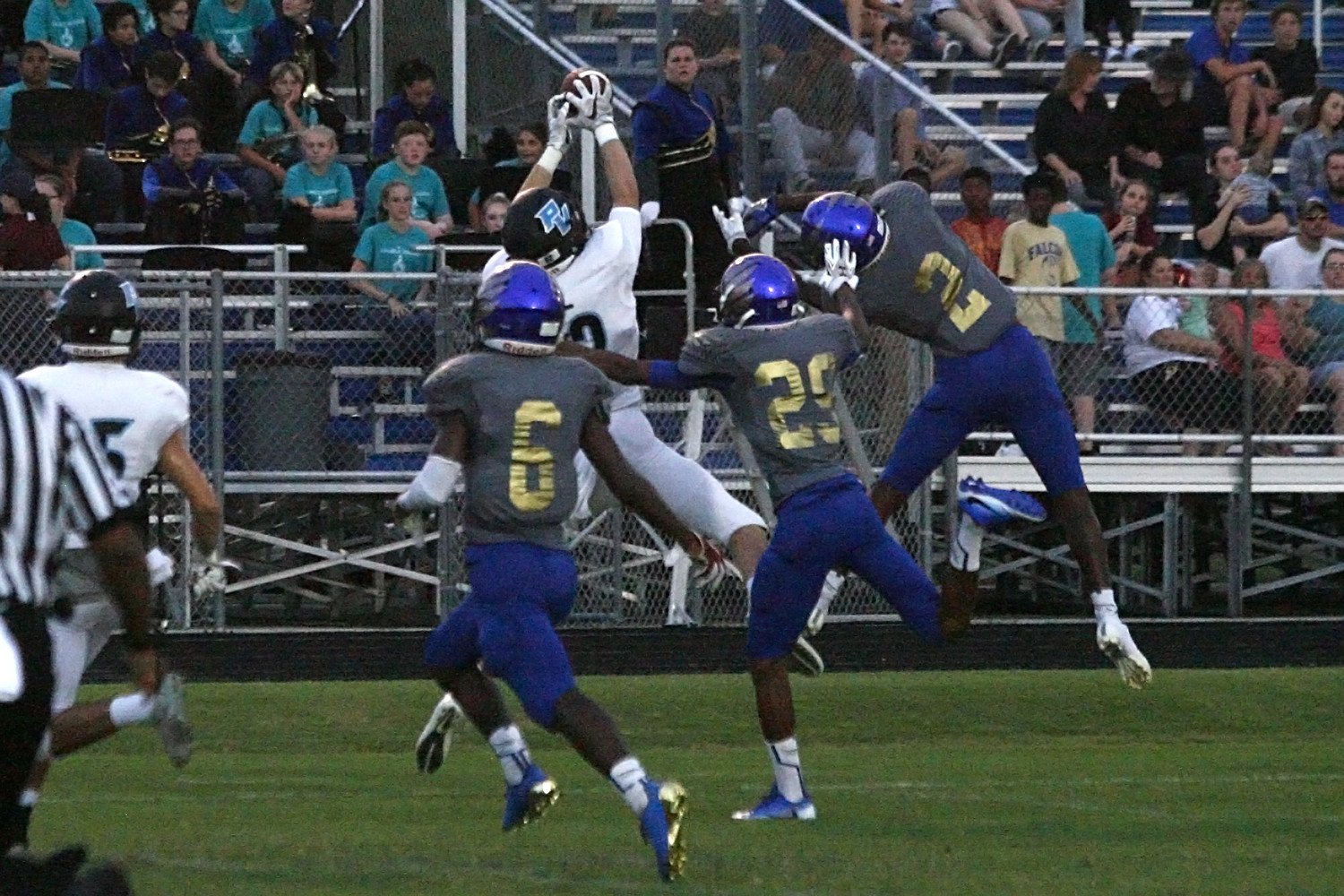 Ponte Vedra's Connor Cawood tries to make a catch against three Pedro Menendez defenders during last Friday's loss.