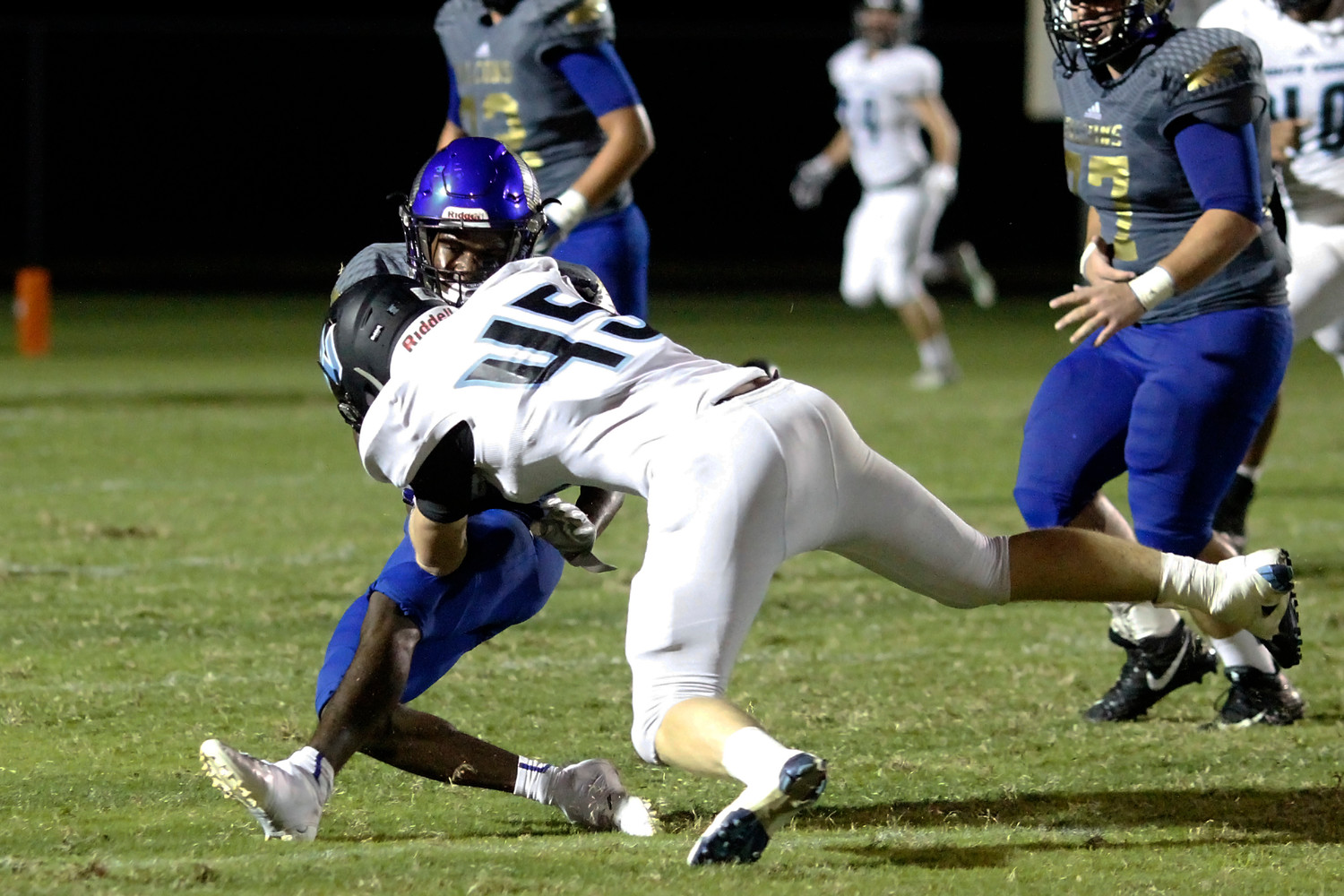 CD James of Ponte Vedra fights off a stiff arm to the face.