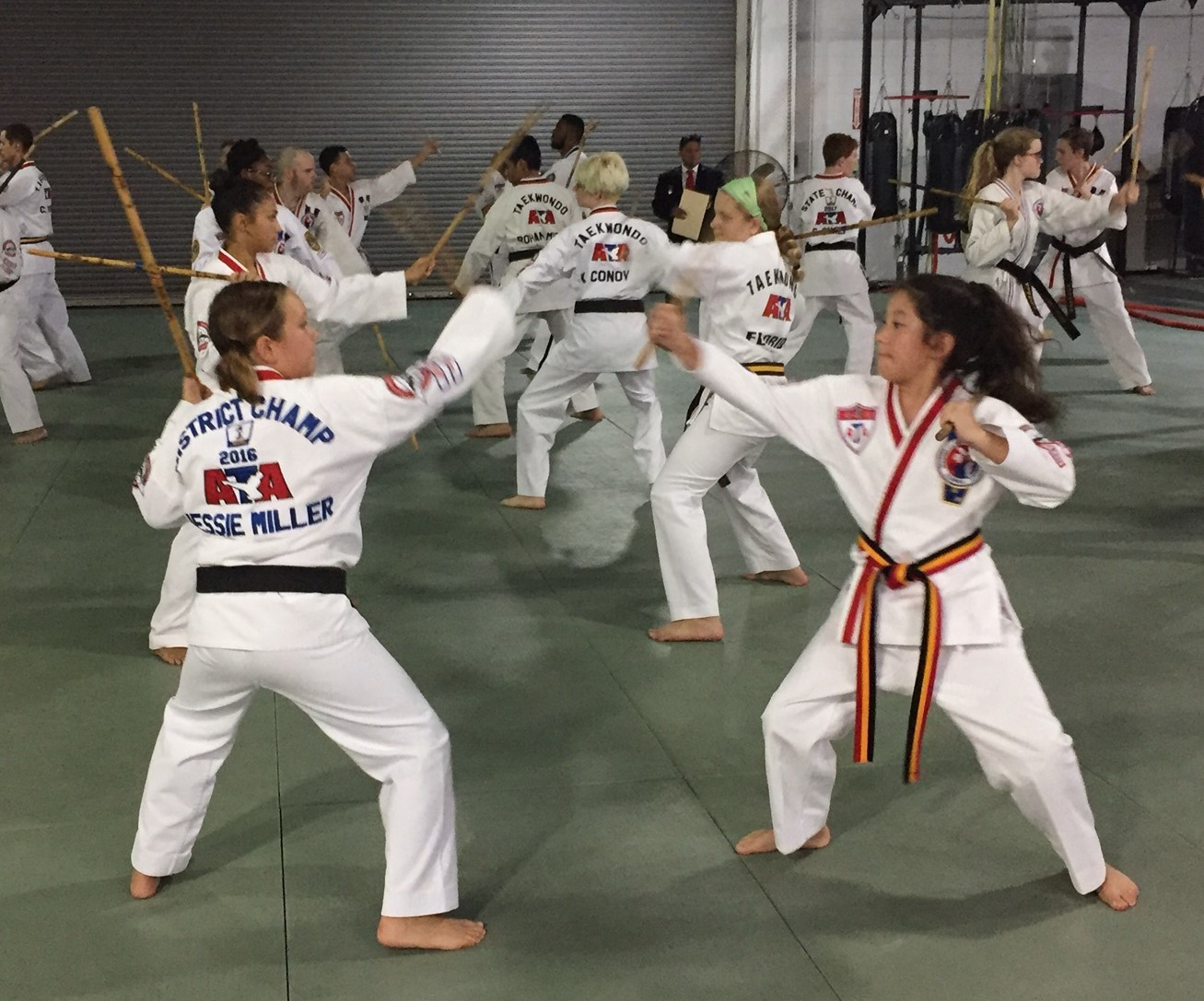 Jessie Miller (left) and Lilly Sonn work on their karate moves.