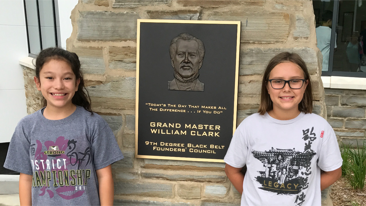 Lilly Sonn (left) and Jessie Miller excelled at testing for their karate teaching certification.