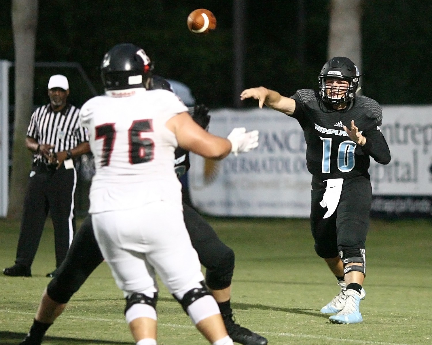 Jack Murrah moves the ball downfield for the Sharks.