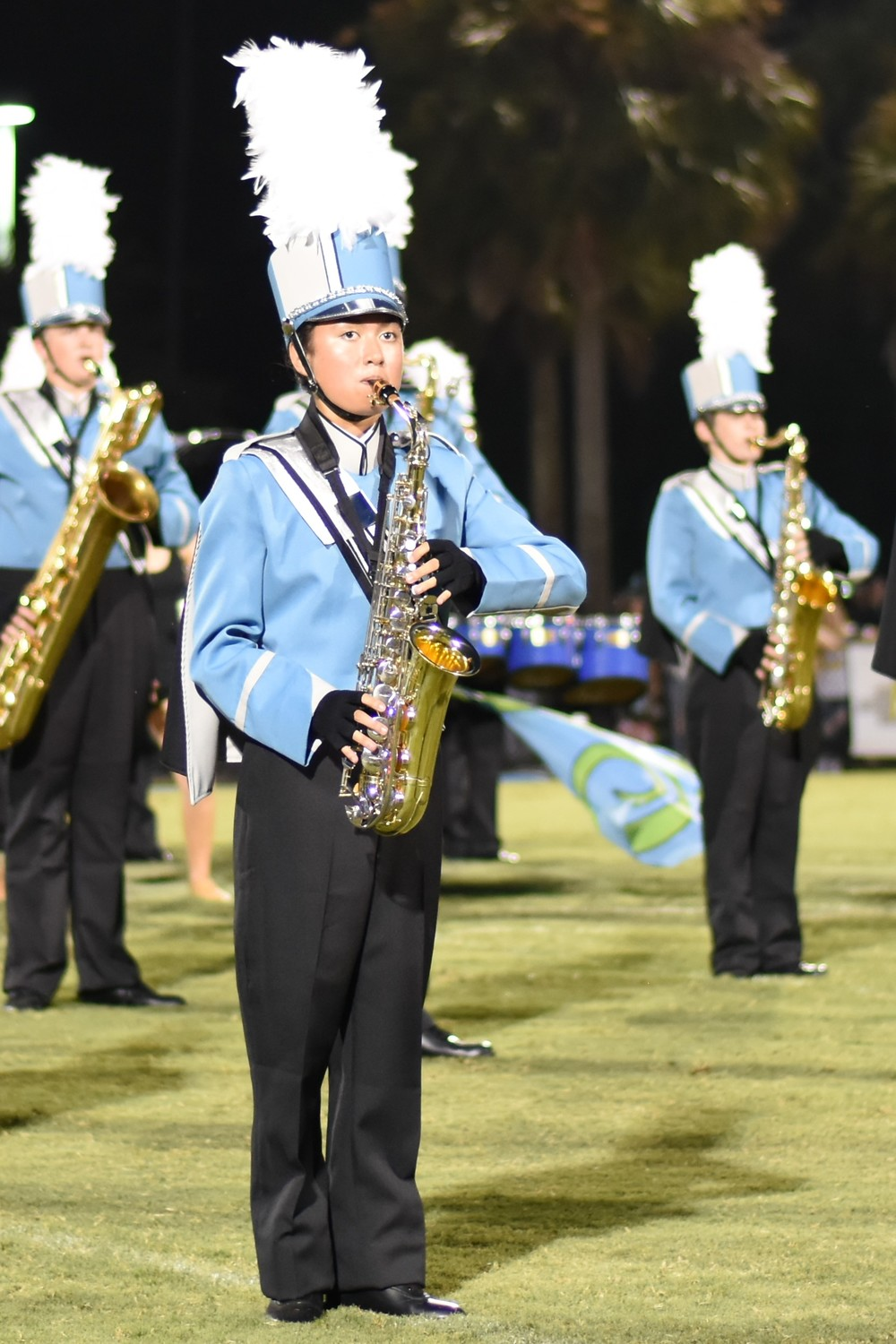 Ponte Vedra High School marching band saxophone player Caitlin Ortiguera performs on Aug. 25 during the Sharks' game at Nease.