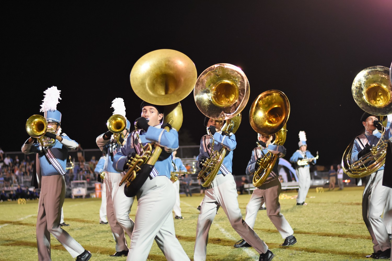 The sousaphone section performs at Pedro Melendez High School's halftime show on Sept. 22.