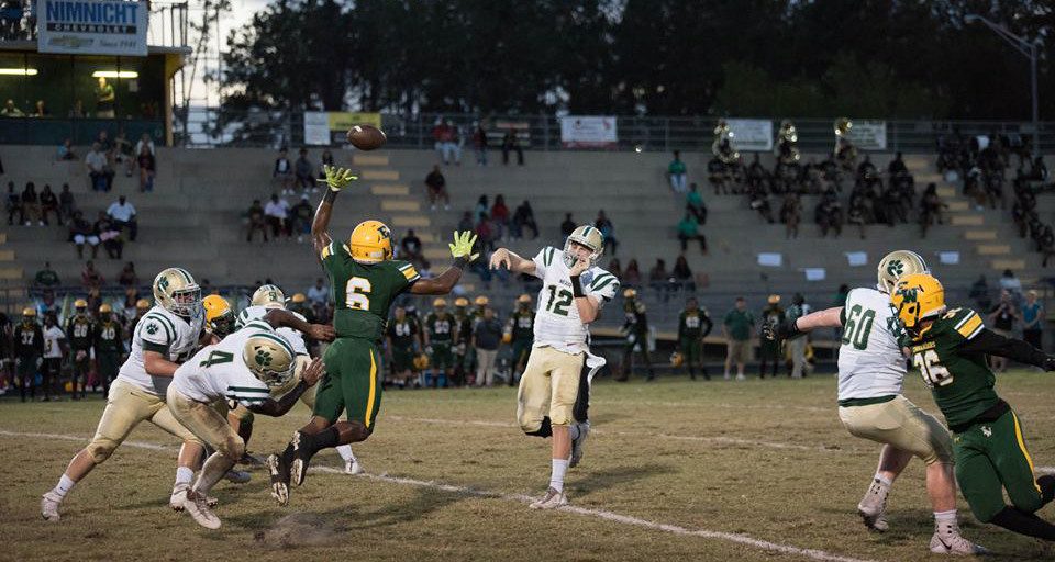 Nease quarterback Preston Staples throws a pass during Friday's game against White. Staples had five touchdowns in the game.