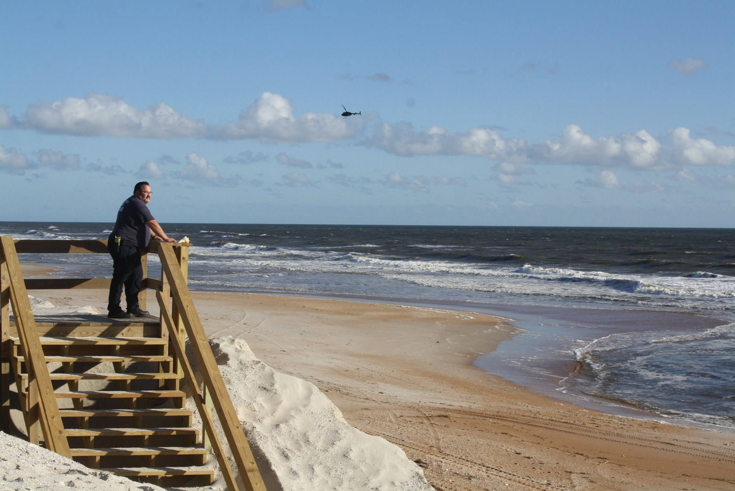 Emergency personnel search by air, boat and ground to locate the swimmer that went missing off South Ponte Vedra Beach Oct. 12. Remains have since been found on the beach that have been identified as the missing swimmer, 47-year-old Dale Robert Kopf of St. Augustine.