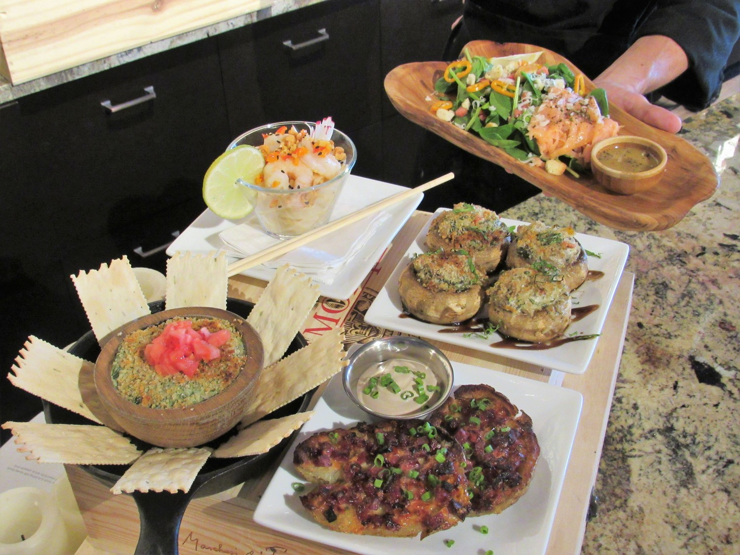 Menu offerings include the Tuscan spinach dip, shrimp pad Thai, Coastal Wine wedges, Rustic stuffed mushrooms and spinach salad with honey dijon vinaigrette.