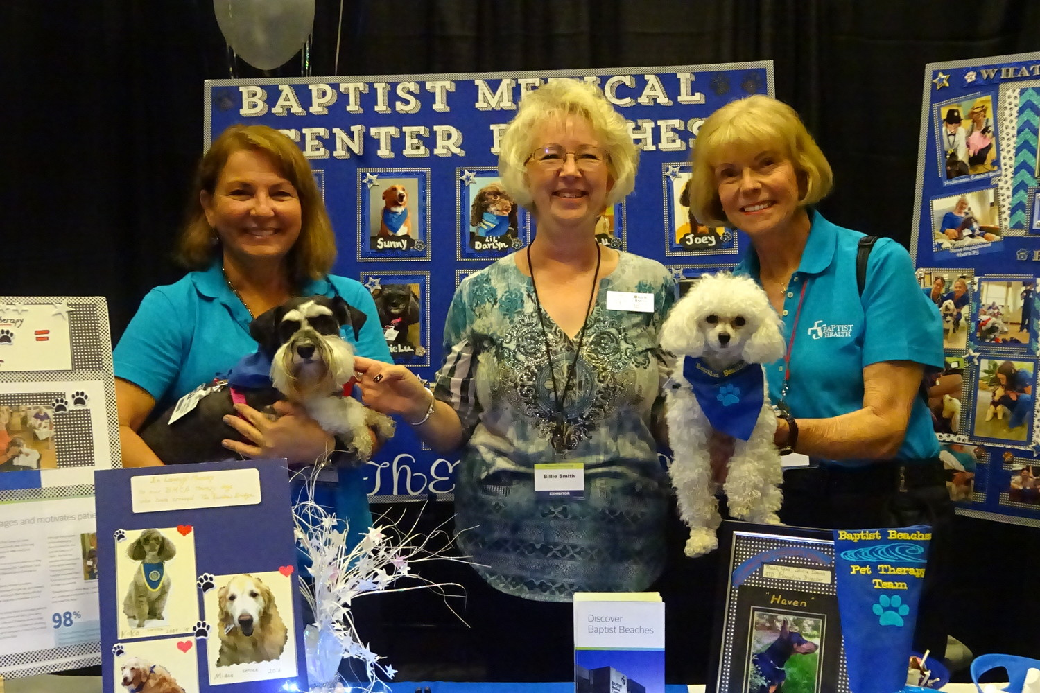 Billie Smith (center), executive director of Alliance of Therapy Dogs, conducts a workshop for people interested in getting started in pet therapy. Beaches residents Marge Gallardo (left) and Marcie Ryan volunteer with their dogs, Lulu Belle and BeBe, at Baptist Medical Center-Beaches.
