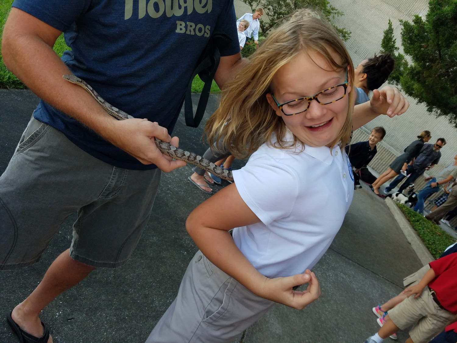 "A snake comes too close for comfort for a girl at ""Blessing of the Pets."""