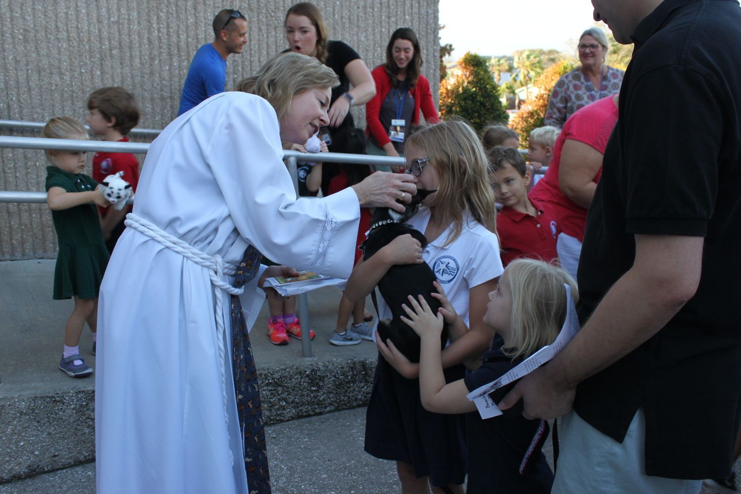 "Attendees enjoy Beaches Episcopal's ""Blessing of the Pets."""