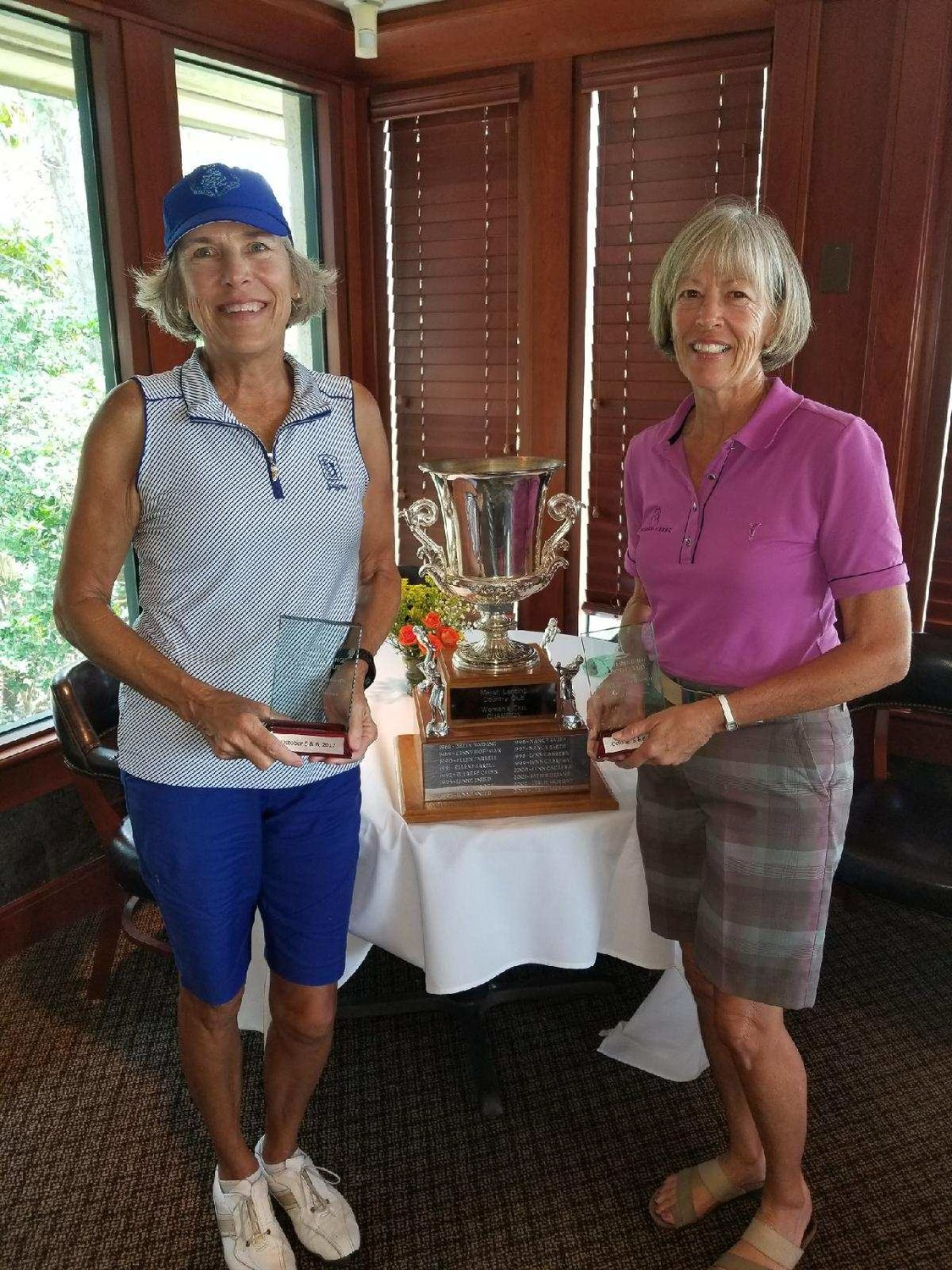 Helen Short (right) won the Marsh Landing Women's Club Championship for the second year in a row, and Peggy Stanley (left) earned the net champion title. The gross champion of the pink tee division was Linda Doran. The tournament was held Oct. 5 and 6 at the Marsh Landing Country Club.