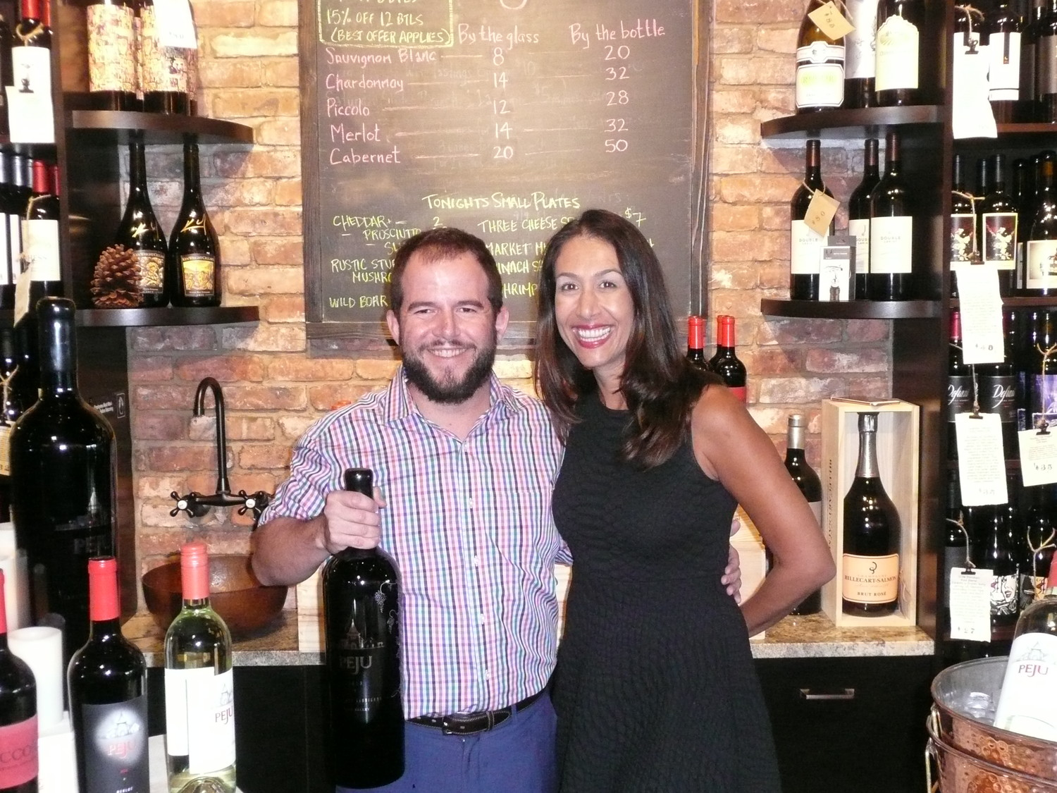 "Coastal Wine Market (CWM) & Tasting Room co-owner Steve Lourie stands with Lisa Peju of Peju Province Winery (Rutherford, California), who was the featured guest for CWM's ""Meet the Winemaker"" event on Thursday, Oct. 19. Peju signed bottles of her highly esteemed wine, and attendees of the event enjoyed a tasting, as well as the opportunity to buy the wine at a discounted price."