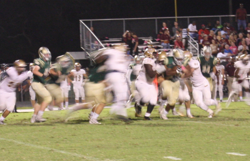 Nease running back Jareem Westcott drags St. Augustine defenders during last Friday's game.
