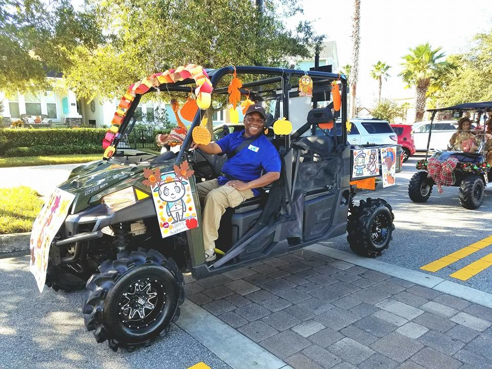 Decorated golf carts take part in last year's Turkey Trot parade